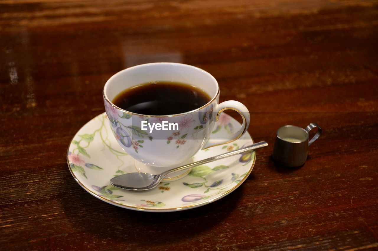 drink, food and drink, refreshment, crockery, saucer, mug, cup, table, tea, tea - hot drink, hot drink, wood - material, tea cup, spoon, eating utensil, coffee cup, kitchen utensil, no people, coffee, freshness, floral pattern, black tea, non-alcoholic beverage
