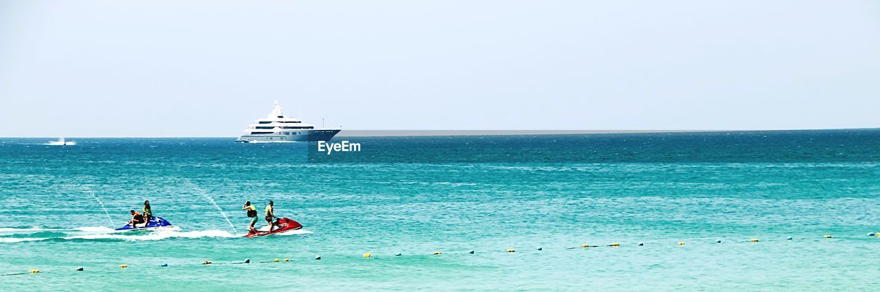 sea, horizon over water, water, transportation, nautical vessel, copy space, scenics, beauty in nature, two people, clear sky, sky, nature, real people, vacations, outdoors, day, beach, women, men, adventure, togetherness, jet boat, adult, people, adults only
