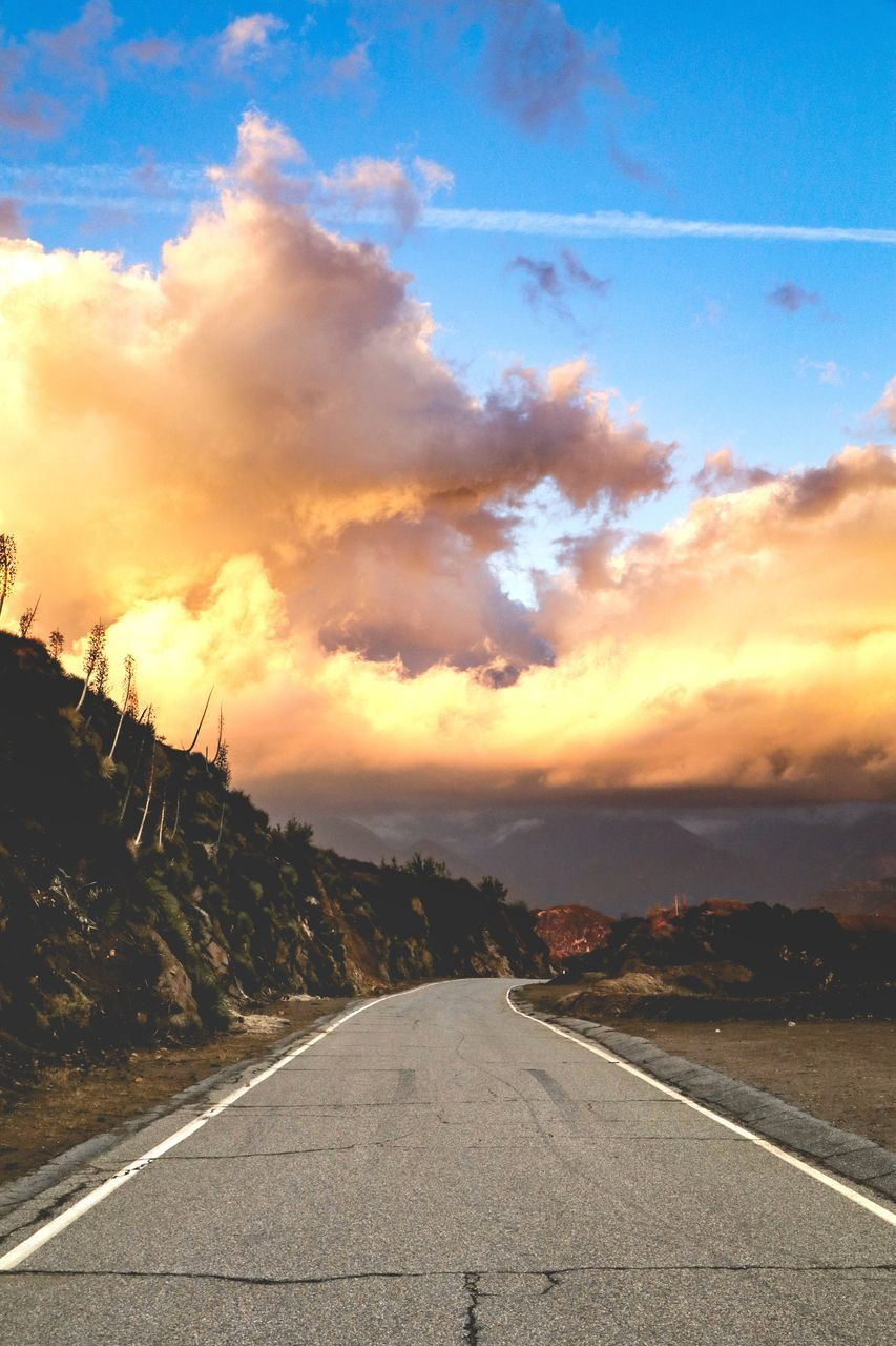 sky, transportation, cloud - sky, road, direction, the way forward, sunset, sign, symbol, nature, diminishing perspective, no people, marking, road marking, vanishing point, beauty in nature, mountain, connection, tranquility, outdoors, dividing line