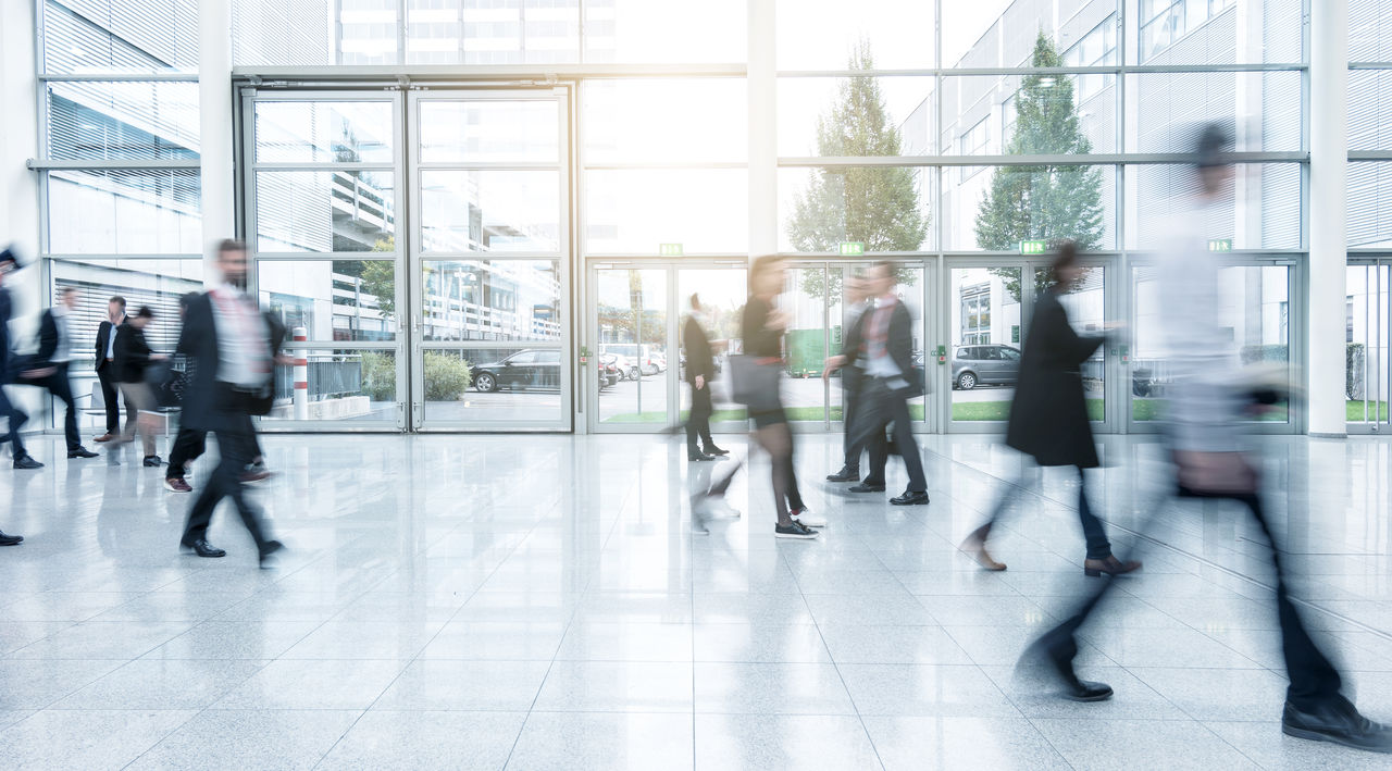 People Walking In Modern Office Building