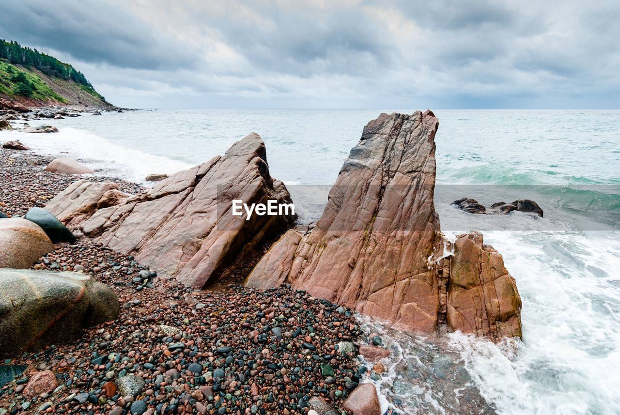 sea, water, sky, land, rock, beach, horizon over water, beauty in nature, cloud - sky, scenics - nature, solid, rock - object, horizon, nature, tranquil scene, tranquility, day, motion, rock formation, no people, outdoors, rocky coastline