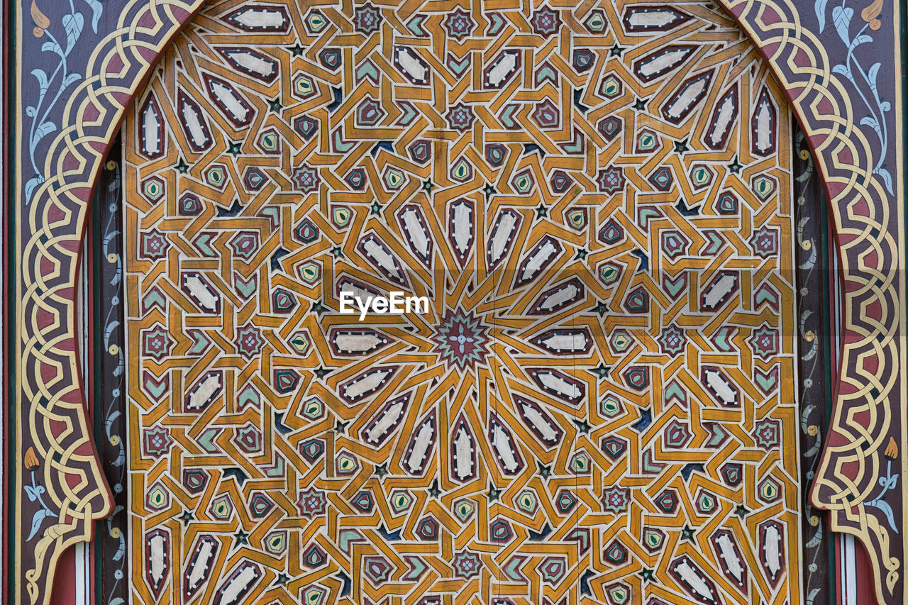 pattern, art and craft, design, creativity, no people, floral pattern, craft, close-up, built structure, architecture, full frame, backgrounds, multi colored, indoors, shape, day, religion, belief, place of worship, wood - material, ceiling, ornate, directly below