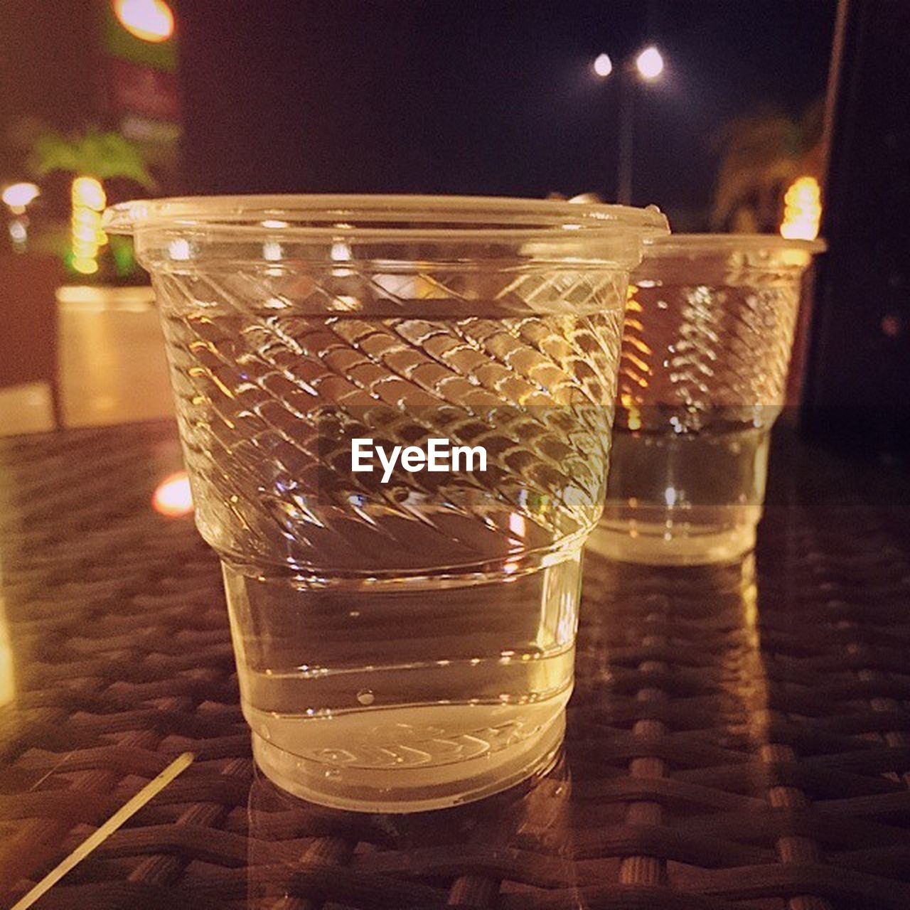 food and drink, drink, refreshment, drinking glass, indoors, table, freshness, no people, close-up, focus on foreground, night, alcohol, cold temperature, food, illuminated