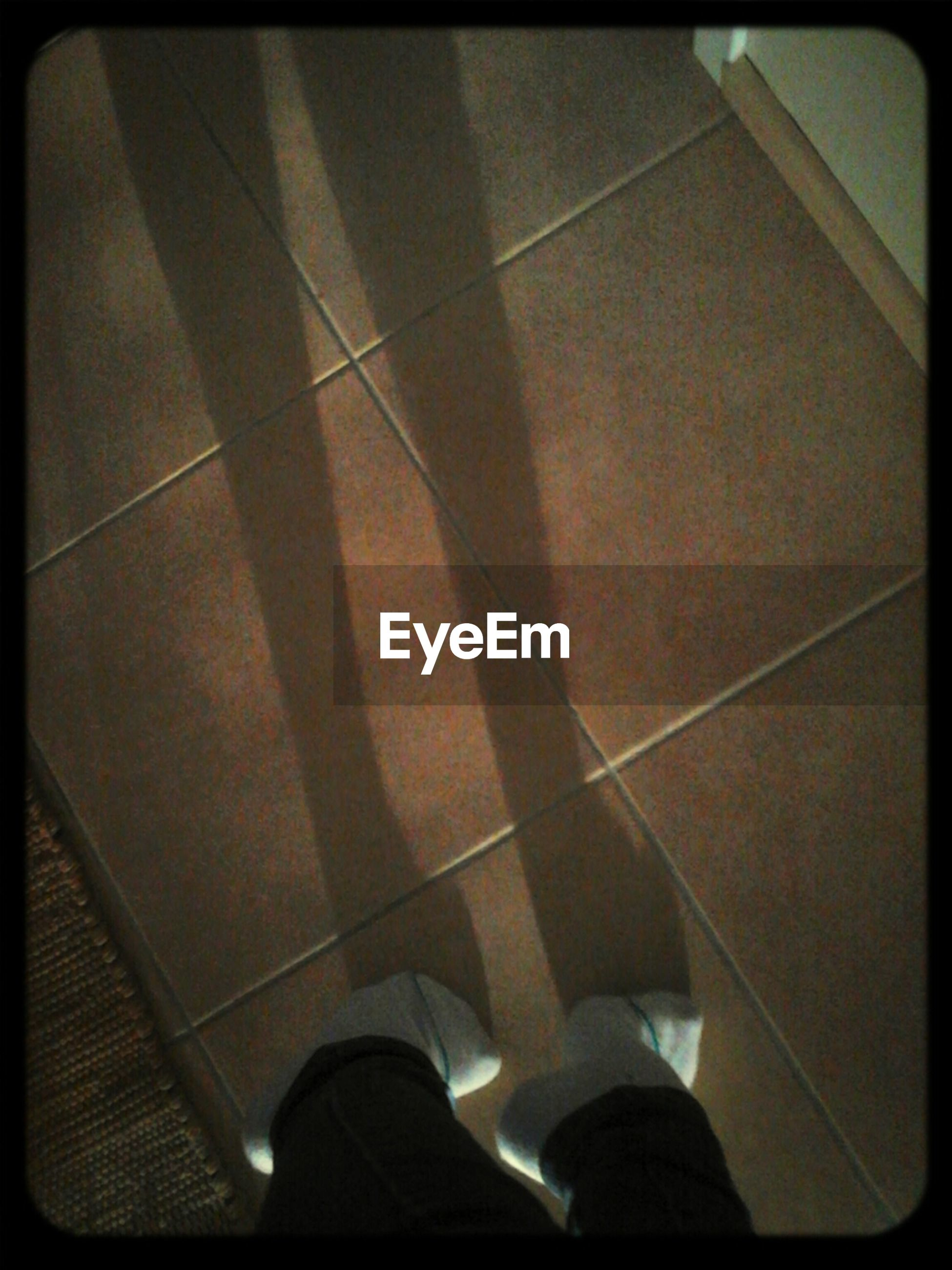 transfer print, low section, person, auto post production filter, shoe, personal perspective, indoors, high angle view, shadow, standing, tiled floor, lifestyles, human foot, unrecognizable person, men, sunlight, footwear