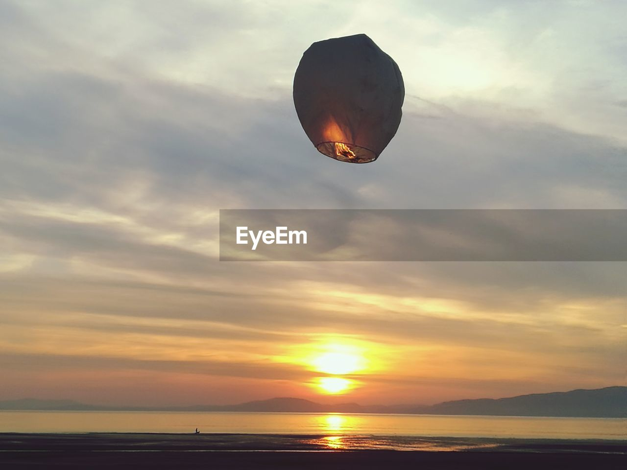 sunset, sky, orange color, scenics, beauty in nature, nature, sun, cloud - sky, tranquil scene, sea, outdoors, mid-air, tranquility, water, no people, day