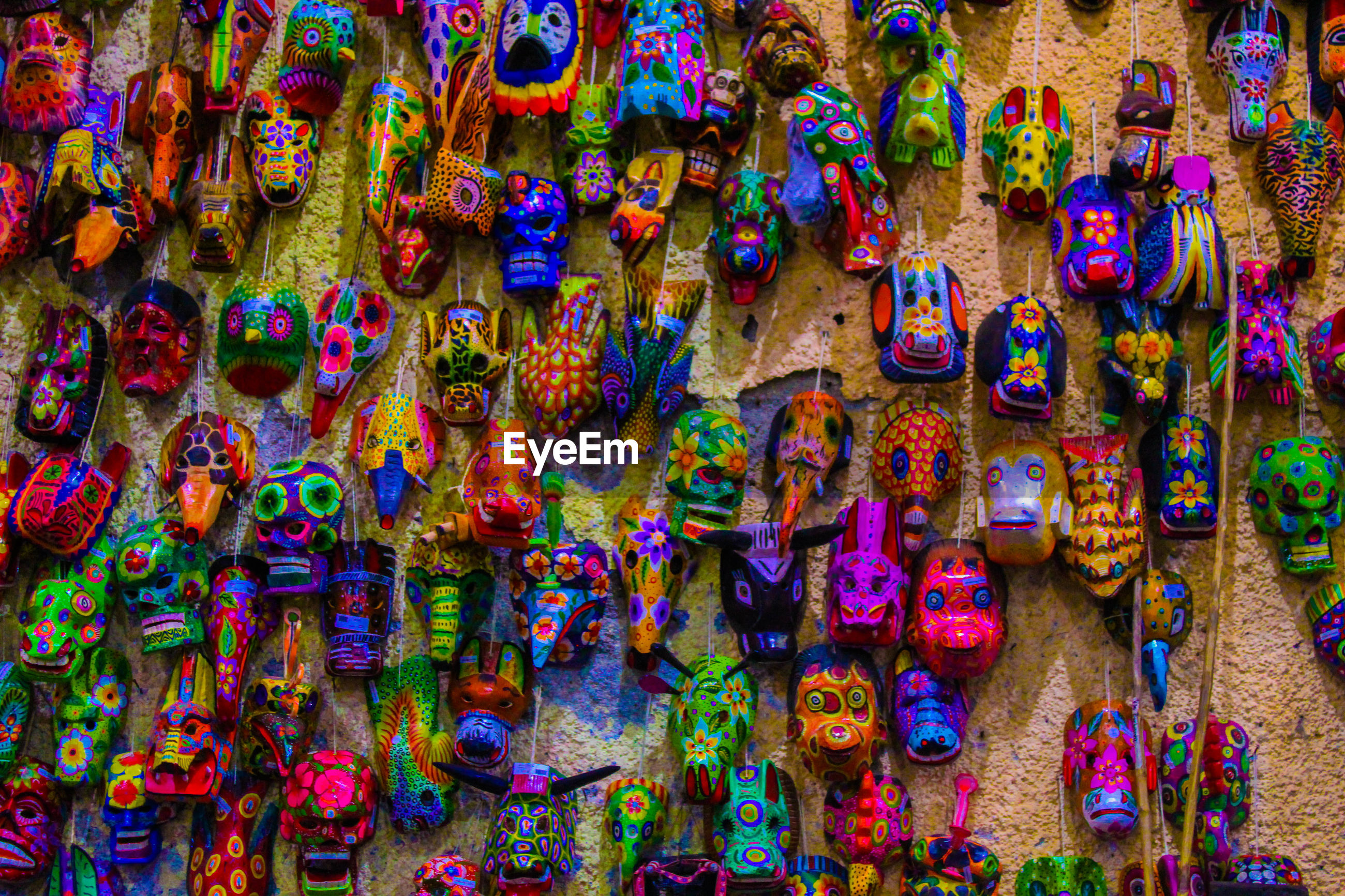 Full frame shot of colorful masks hanging on wall