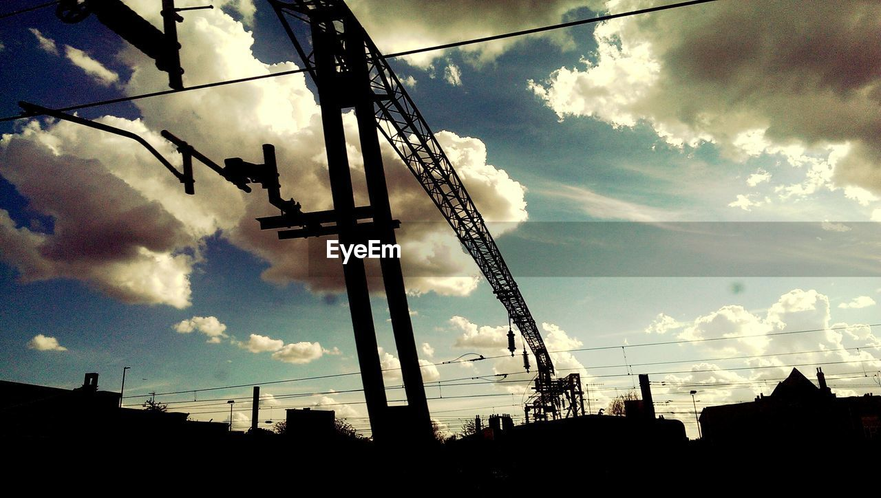 silhouette, sky, cloud - sky, built structure, low angle view, architecture, no people, outdoors, building exterior, sunset, city, day, nature
