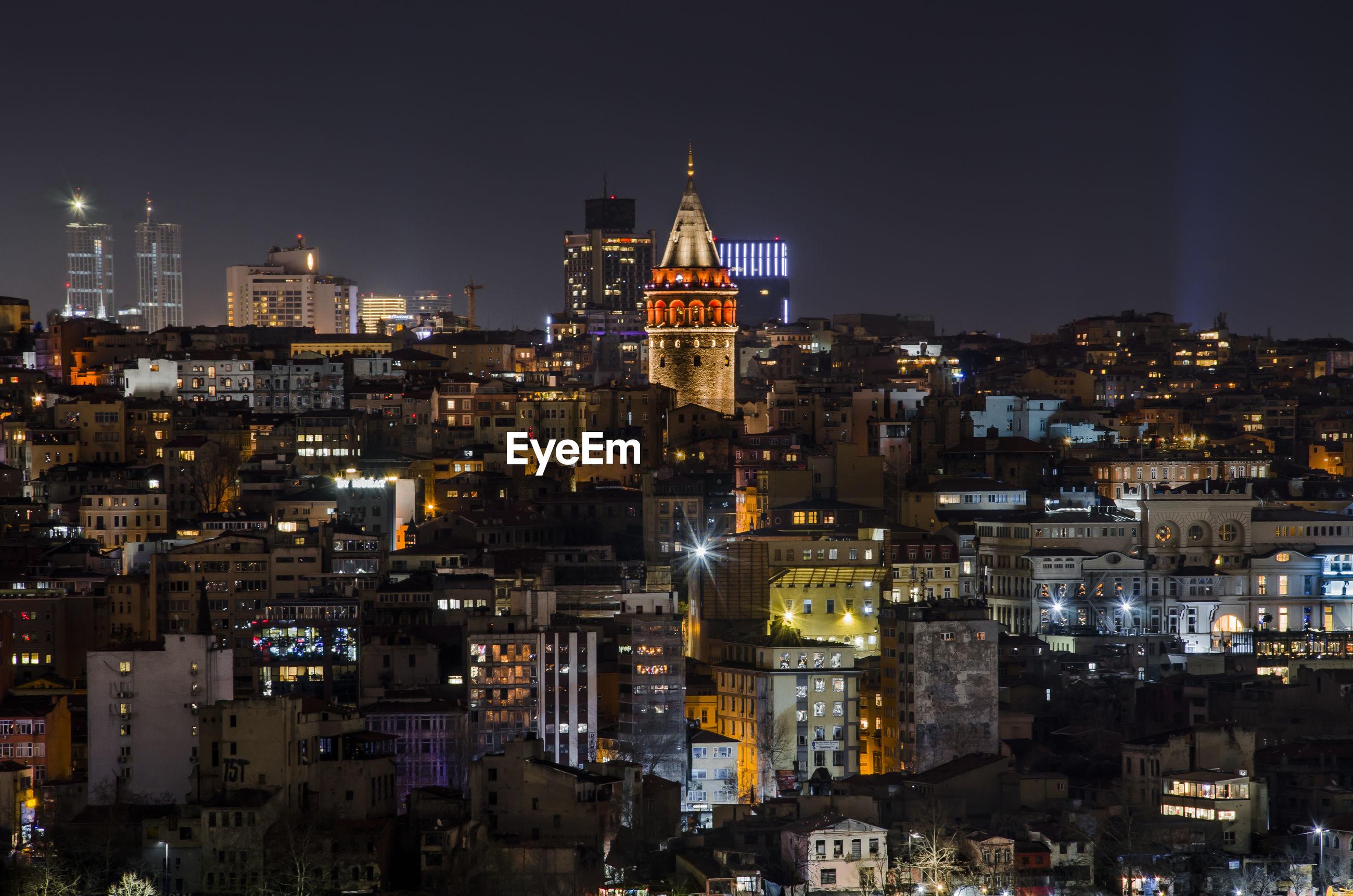 Illuminated galata tower in city at night
