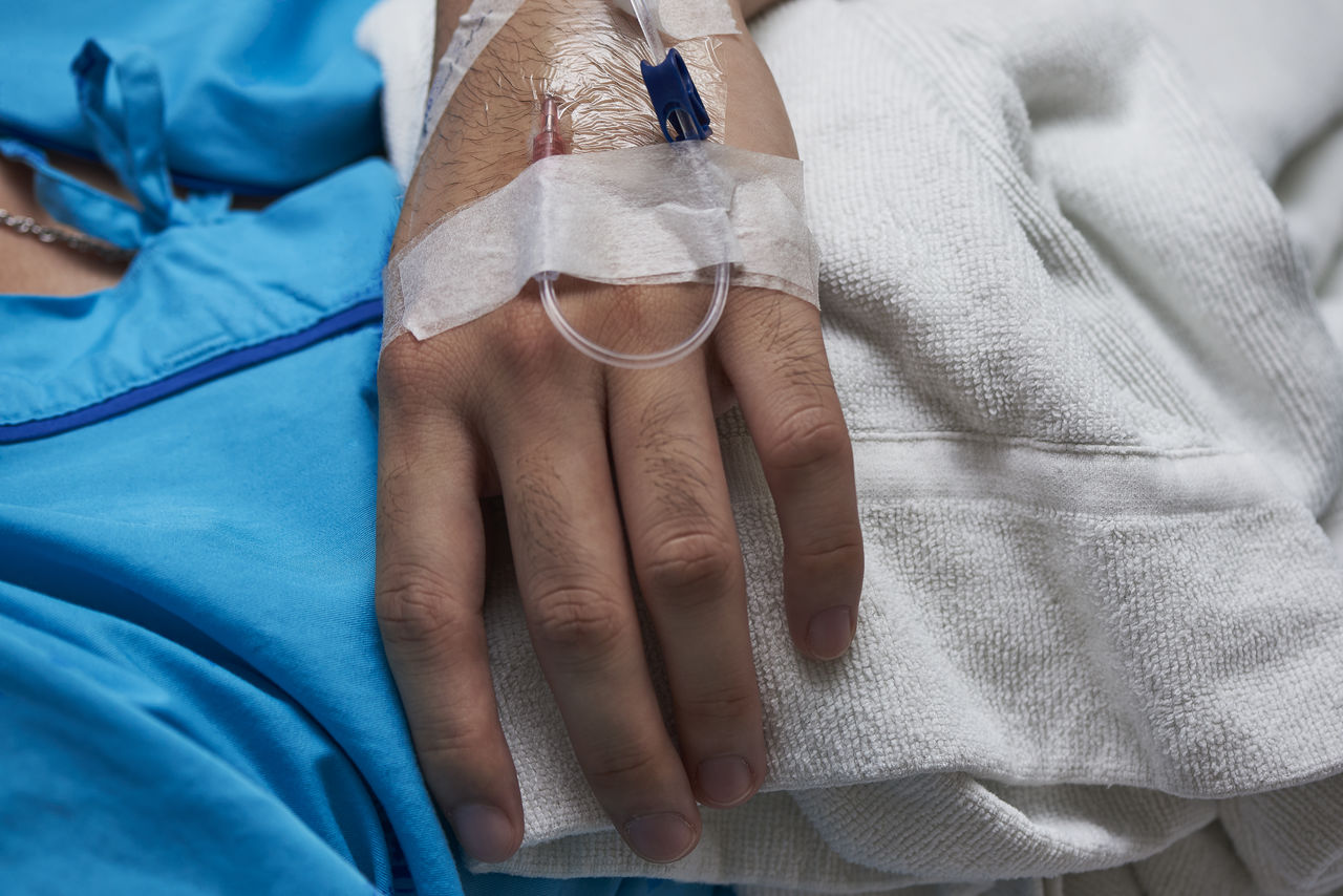 human hand, hand, human body part, real people, adult, hospital, people, indoors, human finger, close-up, finger, women, textile, midsection, togetherness, body part, iv drip, two people, bed, care, positive emotion