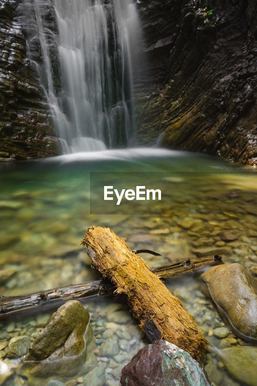 water, waterfall, rock, scenics - nature, rock - object, long exposure, beauty in nature, solid, motion, flowing water, tree, blurred motion, forest, nature, no people, land, flowing, day, moss, outdoors, power in nature, falling water