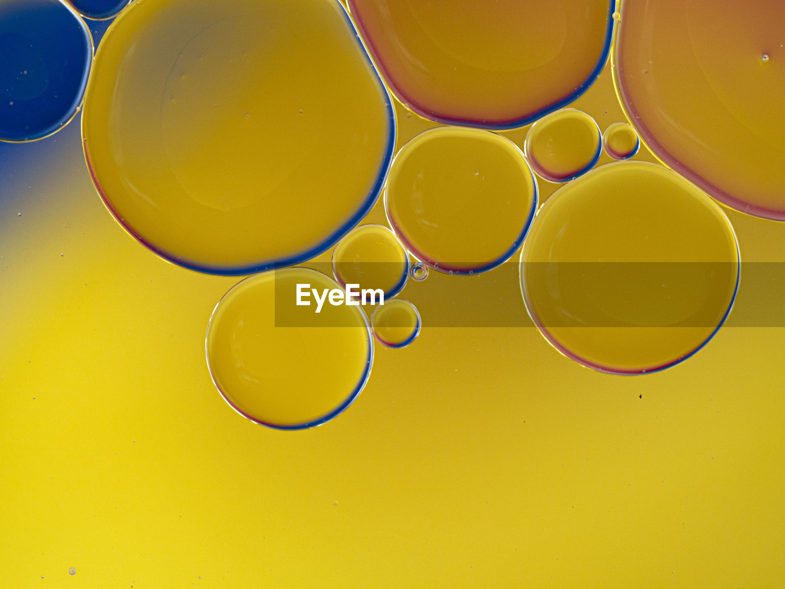 Full frame shot of yellow water bubbles