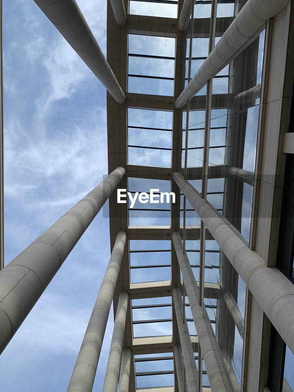 LOW ANGLE VIEW OF PERSON ON STAIRCASE AGAINST SKY