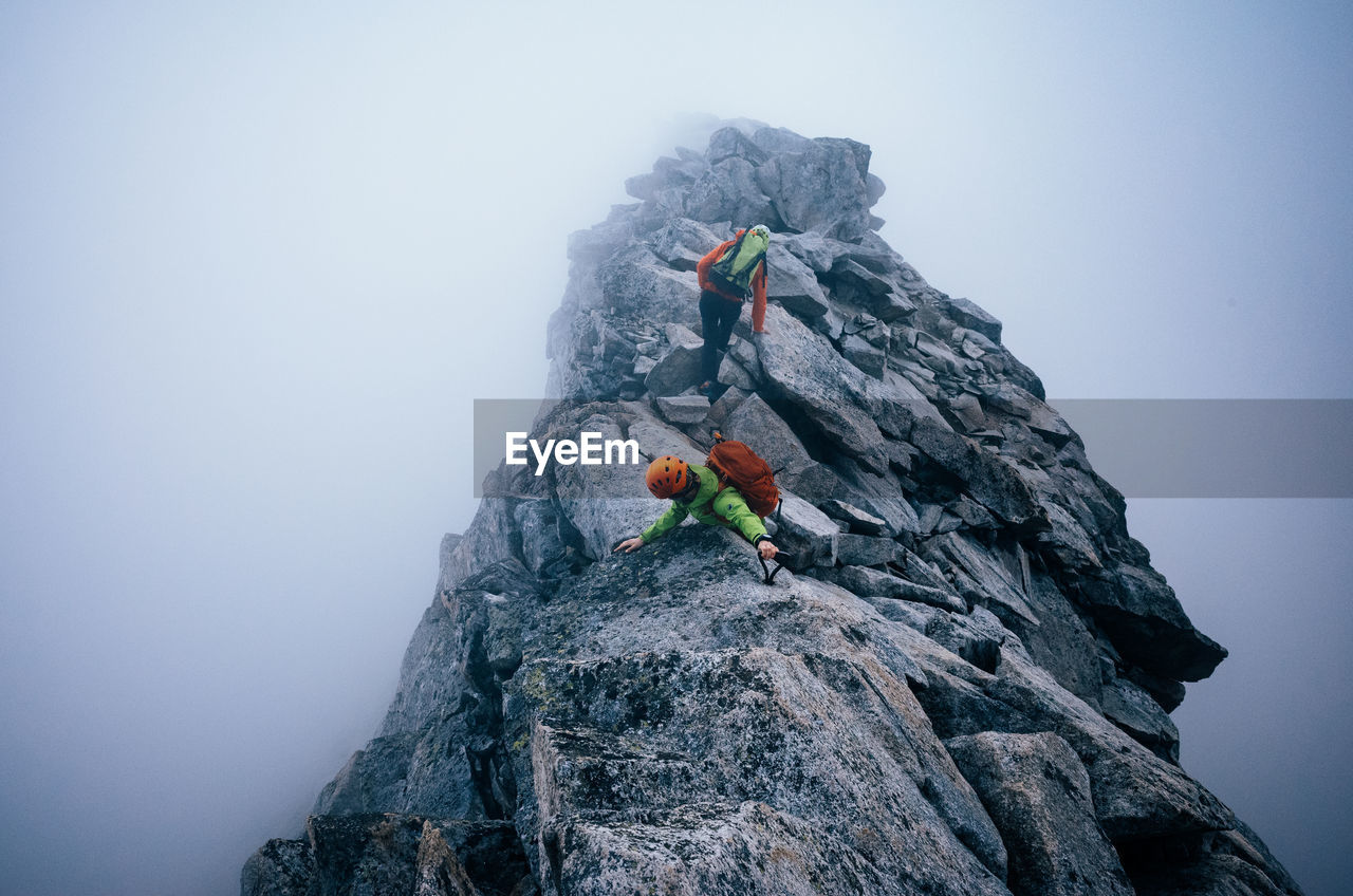 Rock formation on mountain amidst fog