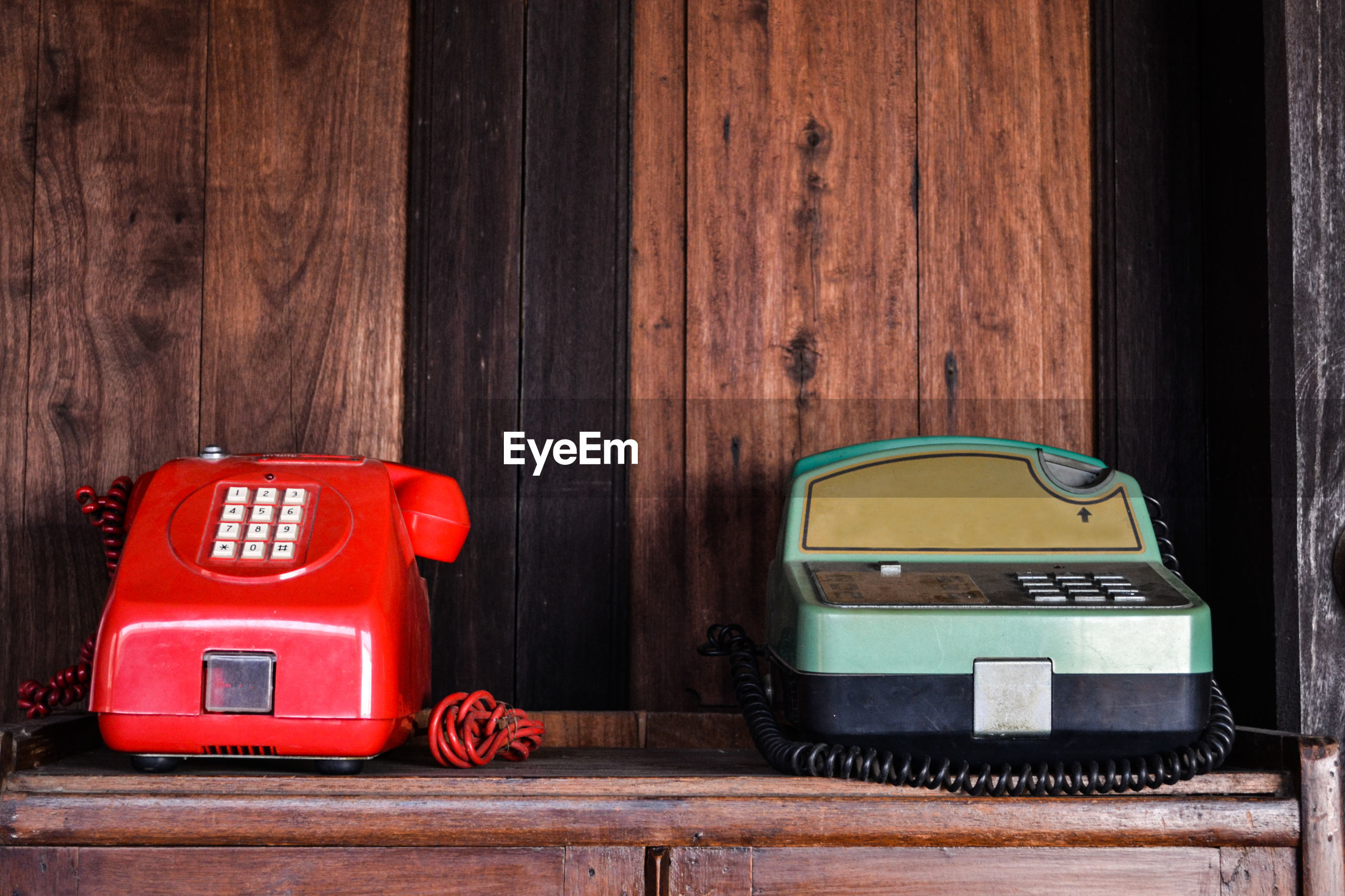 Old telephones on wooden table
