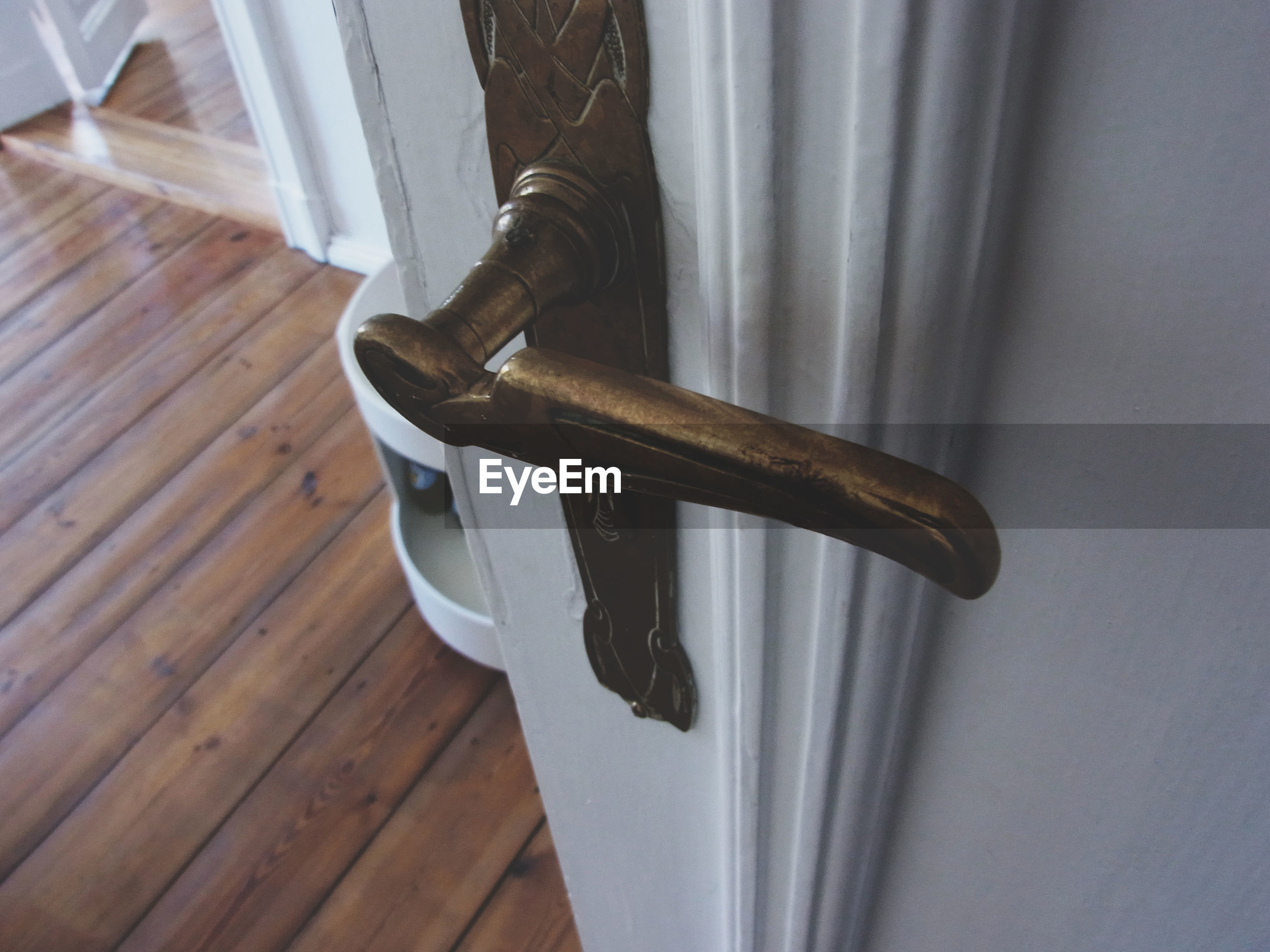 Close-up view of handle of wooden door