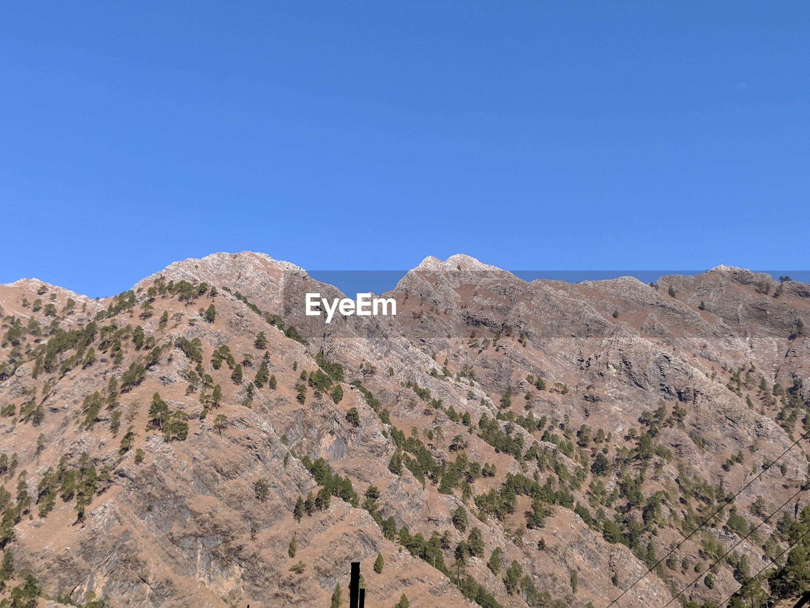 SCENIC VIEW OF MOUNTAIN AGAINST CLEAR SKY