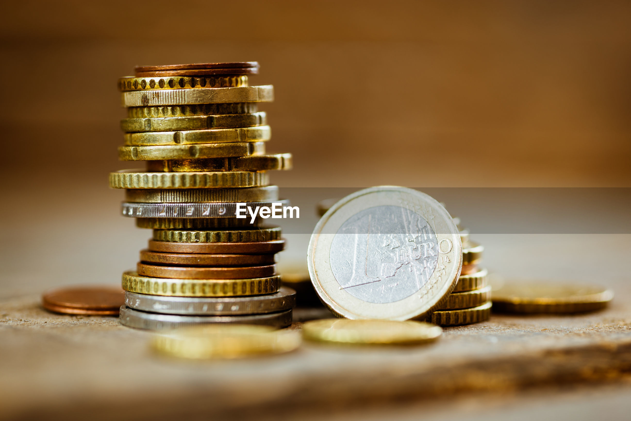STACK OF COINS IN CONTAINER