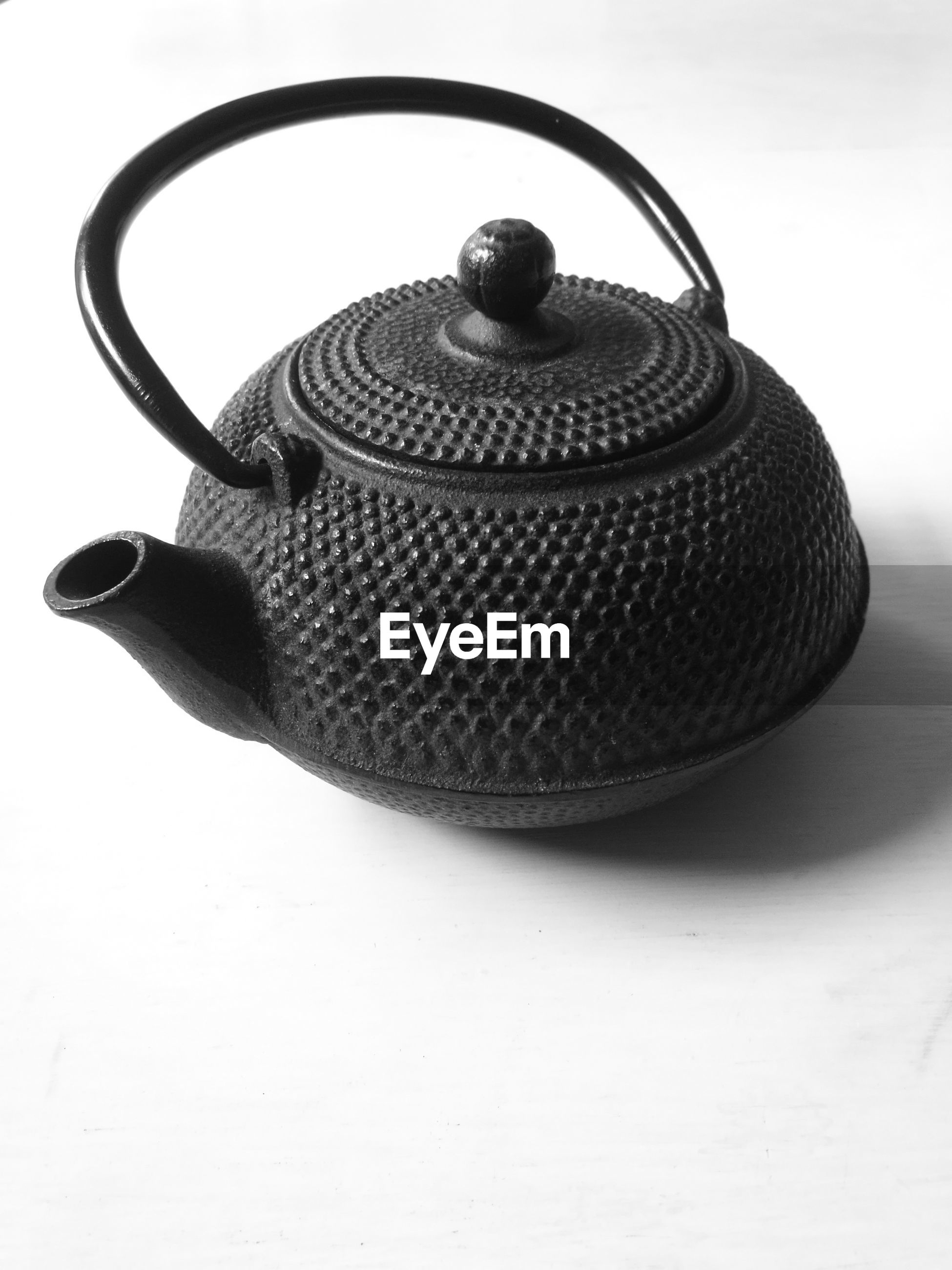 Close-up of teapot on white background