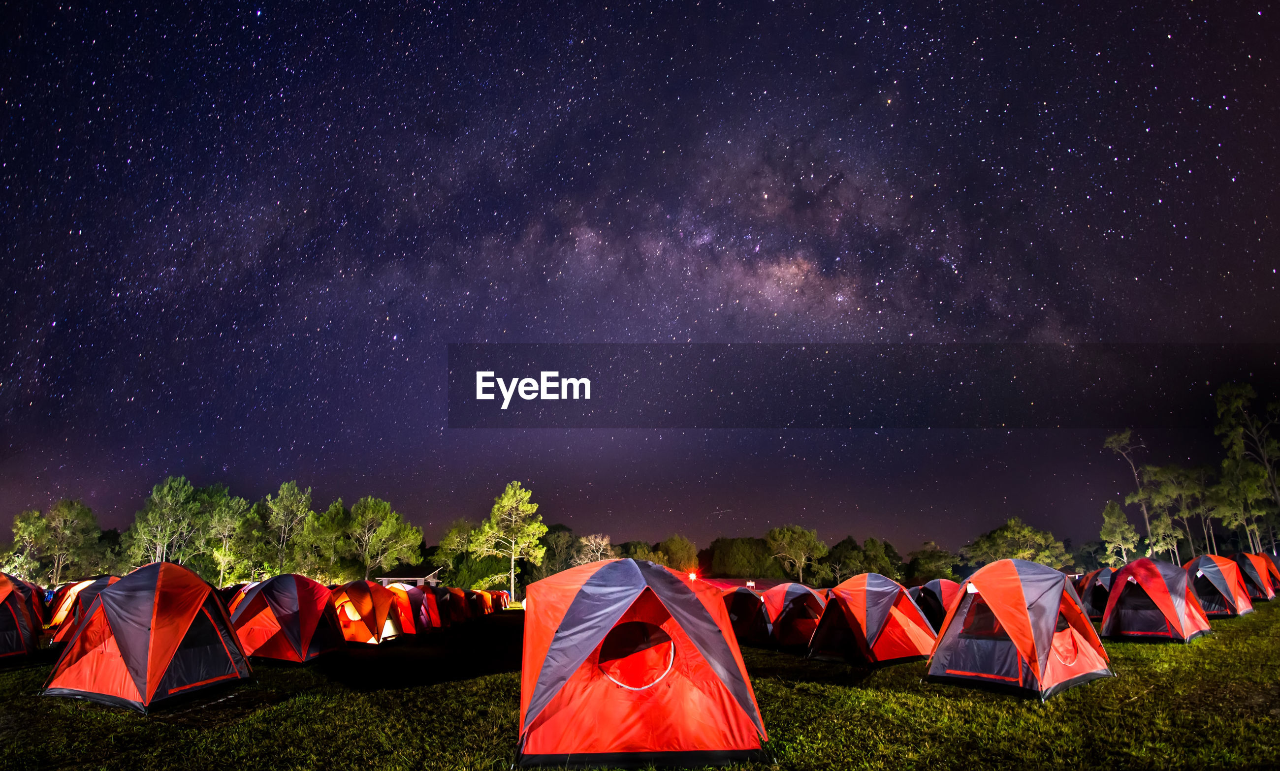 High angle view of tents against on field against star field at night