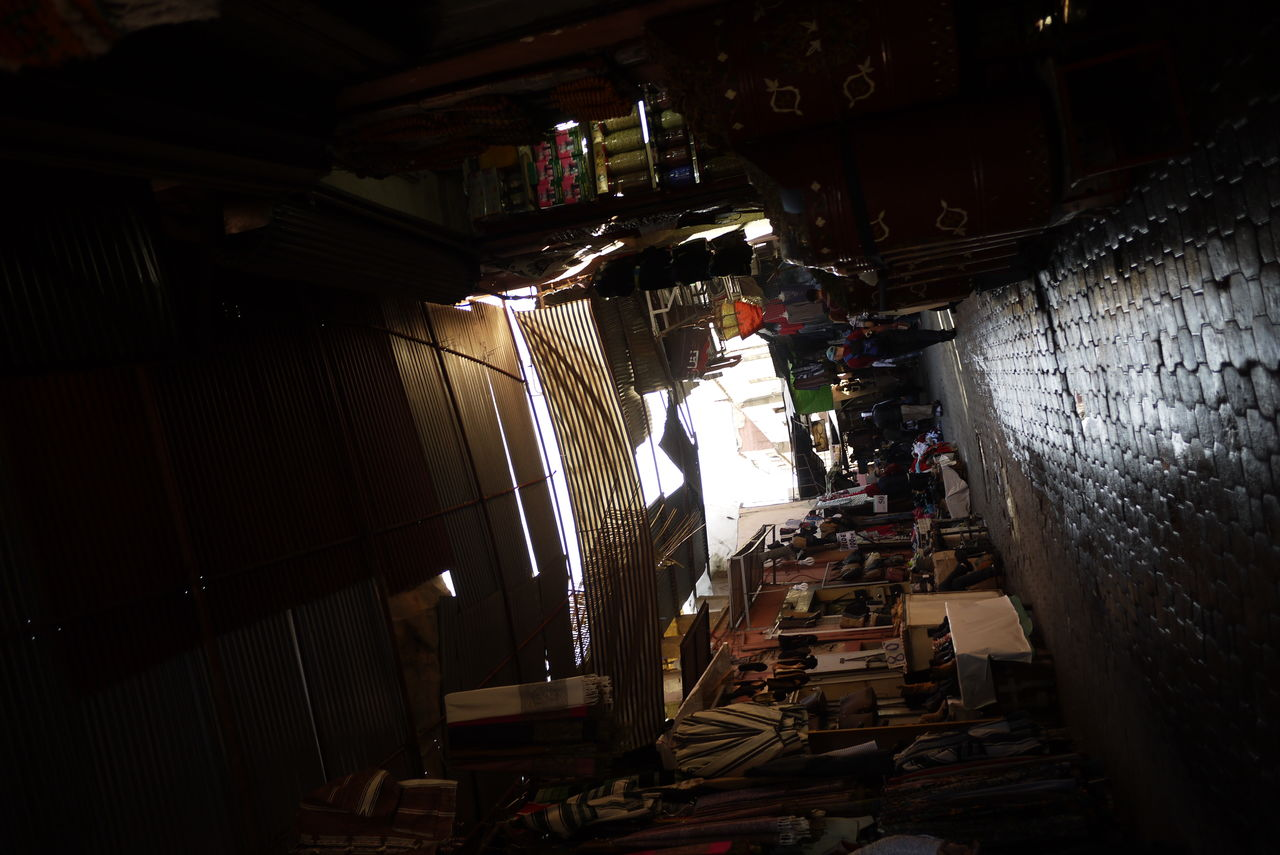 indoors, textile industry, workshop, night, illuminated, one person, men, real people, people