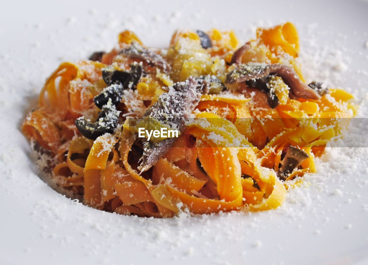 food and drink, food, freshness, ready-to-eat, still life, indoors, close-up, plate, indulgence, italian food, serving size, no people, pasta, temptation, wellbeing, orange color, healthy eating, selective focus, sweet food, garnish