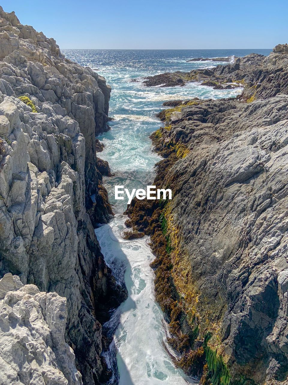 water, sea, rock, beauty in nature, rock - object, solid, motion, scenics - nature, beach, sky, nature, land, aquatic sport, rock formation, wave, surfing, horizon, day, horizon over water, outdoors, rocky coastline, breaking, power in nature, eroded
