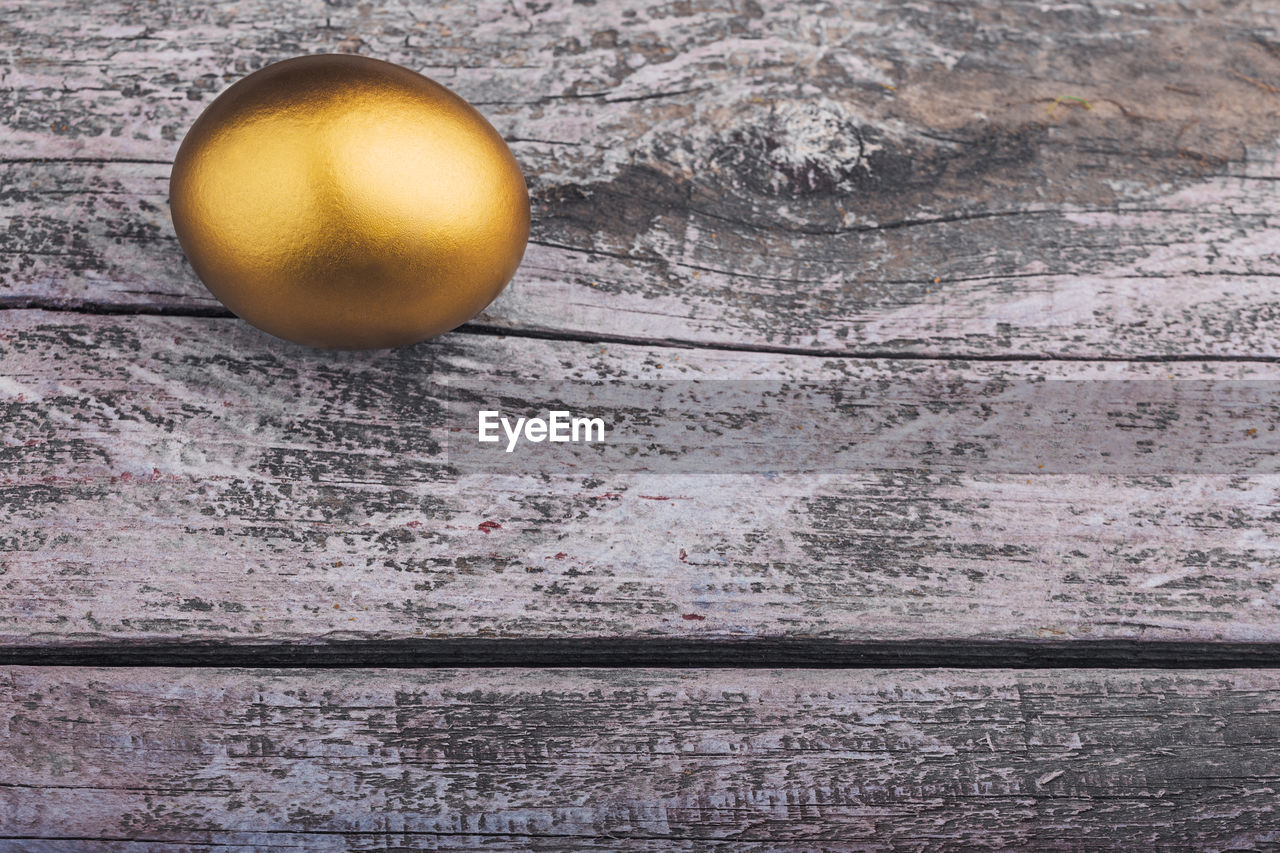 no people, food, wood - material, close-up, indoors, egg, still life, food and drink, directly above, table, single object, wellbeing, day, nature, healthy eating, textured, yellow, wall - building feature, freshness