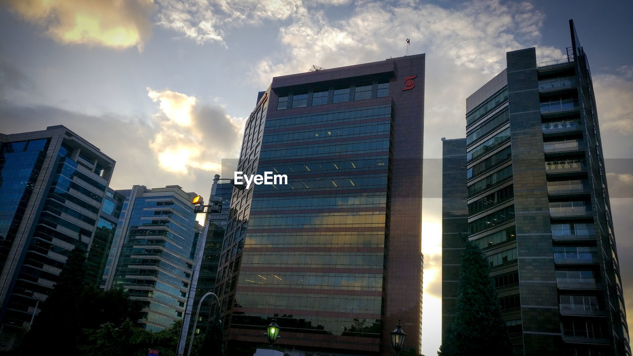architecture, building exterior, skyscraper, built structure, modern, city, low angle view, outdoors, corporate business, growth, sky, no people, tall, day, office park