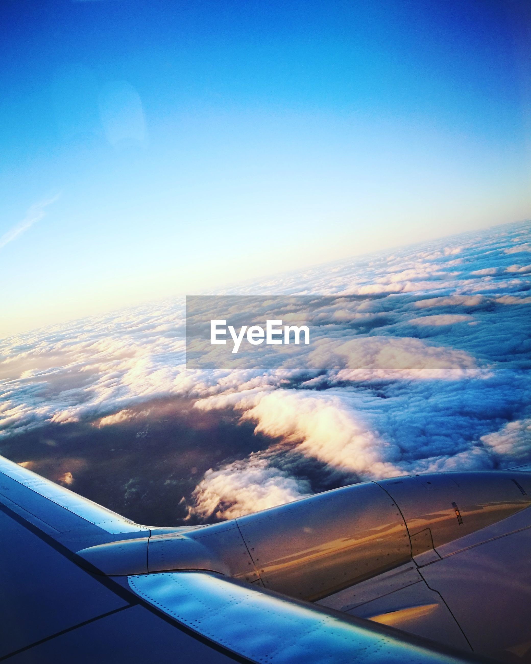airplane, transportation, air vehicle, journey, aerial view, travel, mode of transport, airplane wing, aircraft wing, flying, mid-air, sky, jet engine, nature, blue, cloud - sky, no people, tranquil scene, scenics, day, beauty in nature, outdoors, sky only