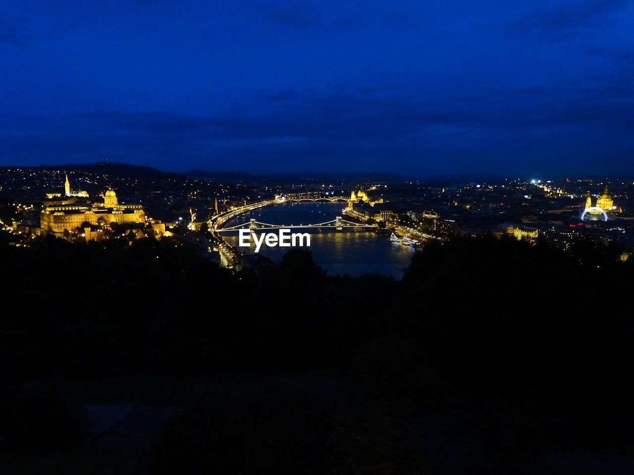architecture, illuminated, night, built structure, city, building exterior, cityscape, sky, no people, nature, water, building, cloud - sky, outdoors, residential district, travel destinations, river, high angle view, chain bridge