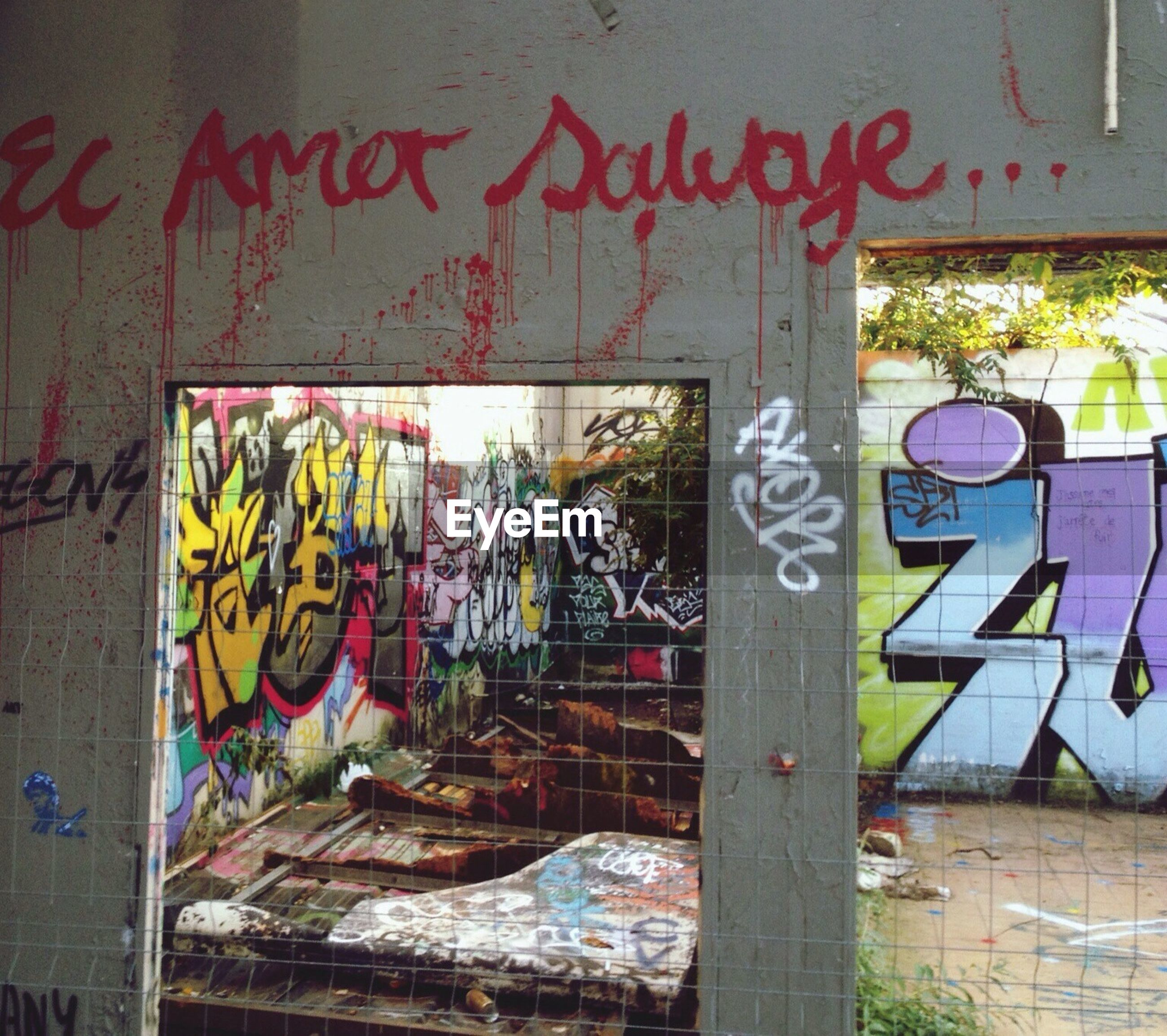 graffiti, art, wall - building feature, creativity, art and craft, architecture, built structure, text, building exterior, wall, street art, western script, multi colored, abandoned, messy, communication, vandalism, no people, damaged, day