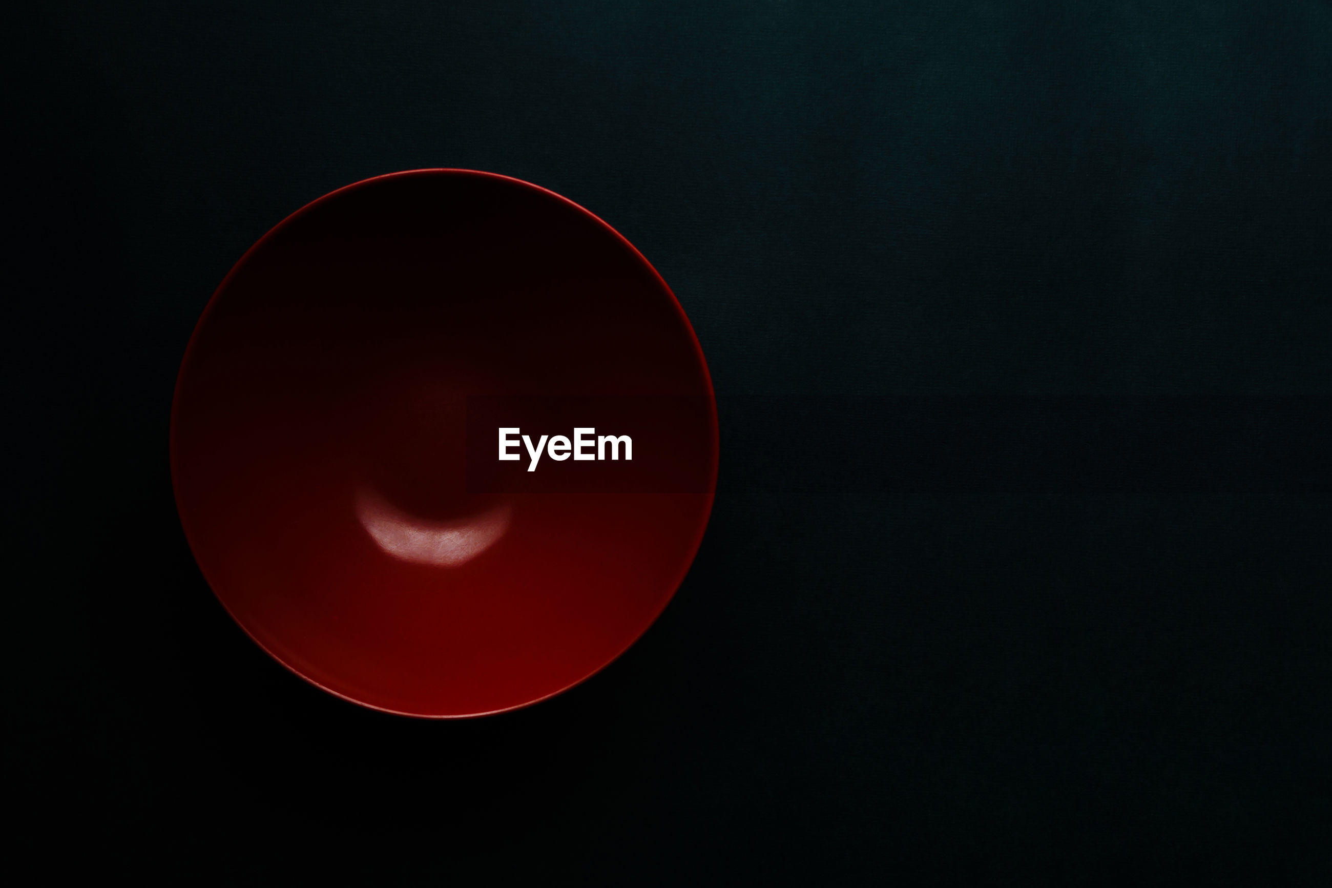 RED MOON AGAINST BLACK SKY