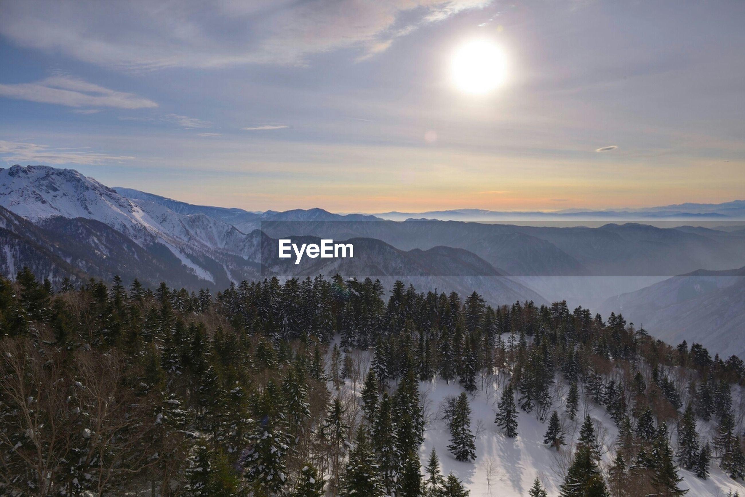mountain, tranquil scene, mountain range, tranquility, scenics, beauty in nature, snow, winter, cold temperature, sun, sky, nature, landscape, season, sunlight, idyllic, cloud - sky, weather, sunset, non-urban scene
