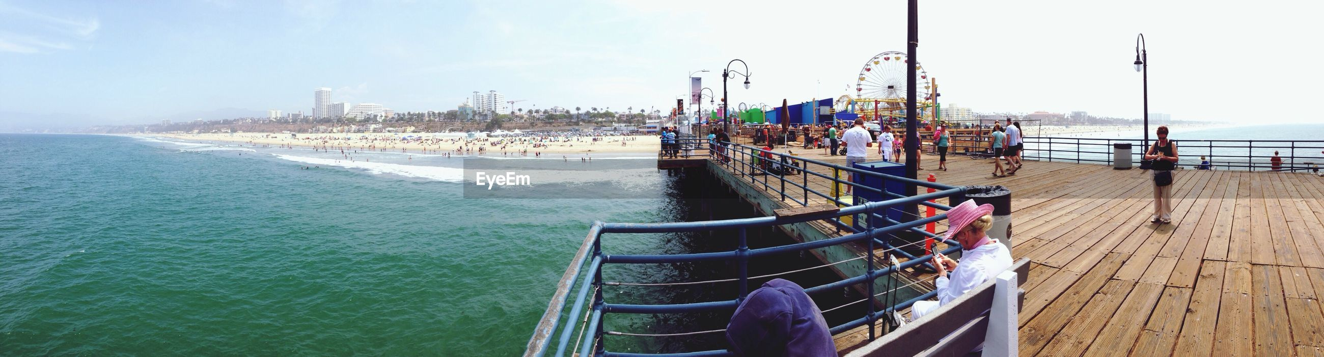 sea, water, nautical vessel, beach, horizon over water, transportation, sky, boat, incidental people, moored, shore, mode of transport, sand, pier, sunlight, day, nature, medium group of people, vacations, harbor