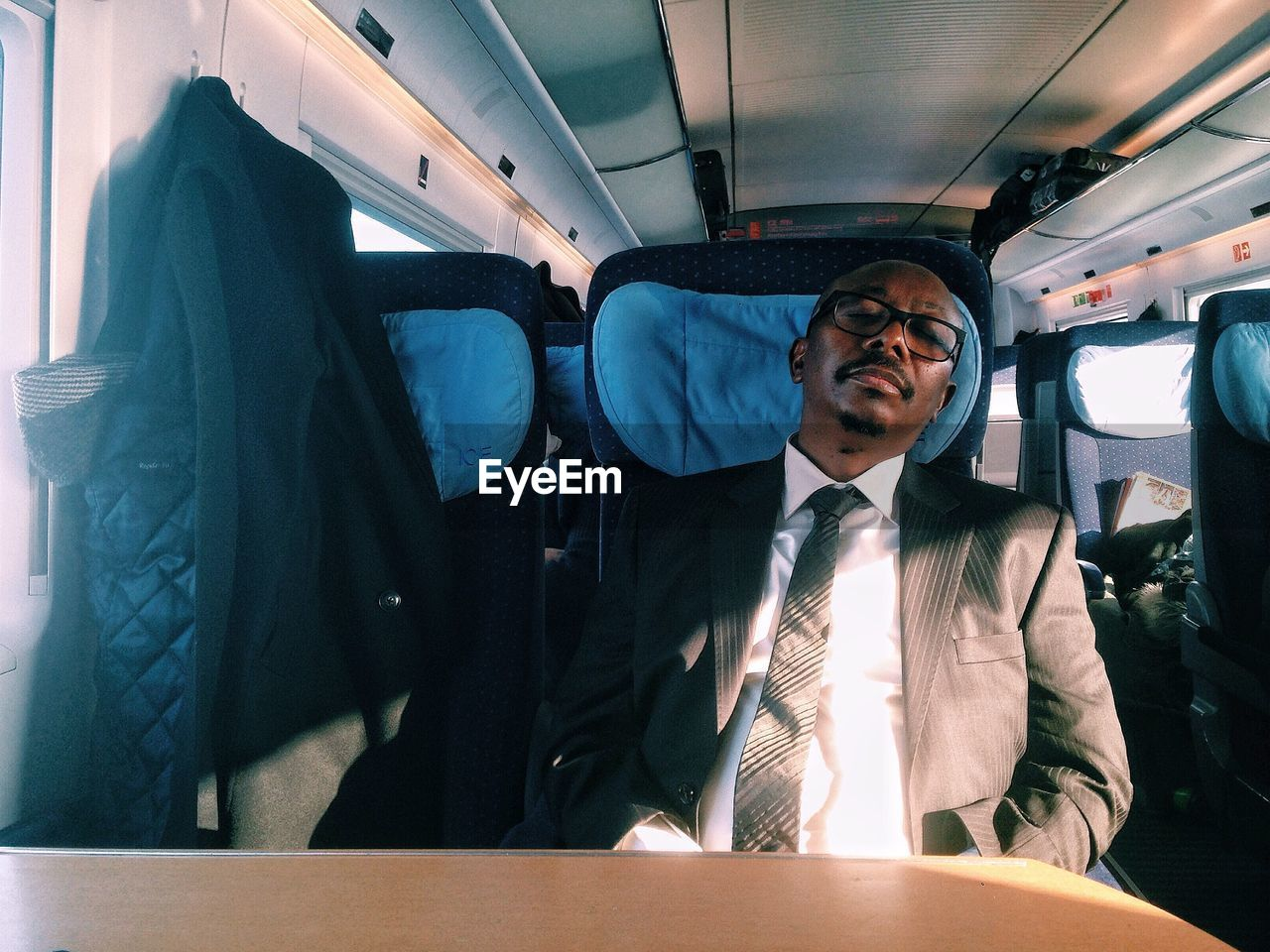 Businessman Sleeping While Traveling In Train