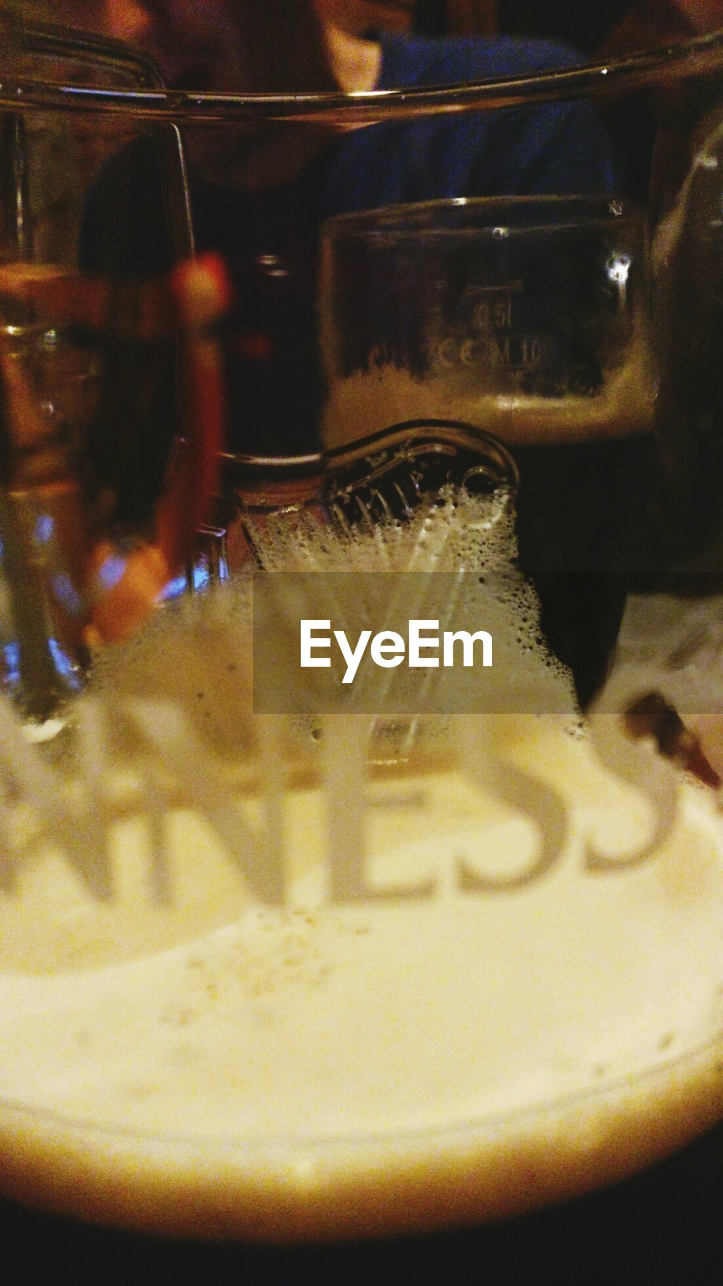 indoors, close-up, glass - material, reflection, still life, cold temperature, transparent, no people, drink, selective focus, night, food and drink, illuminated, table, focus on foreground, refreshment, old-fashioned, drinking glass, glass, motion