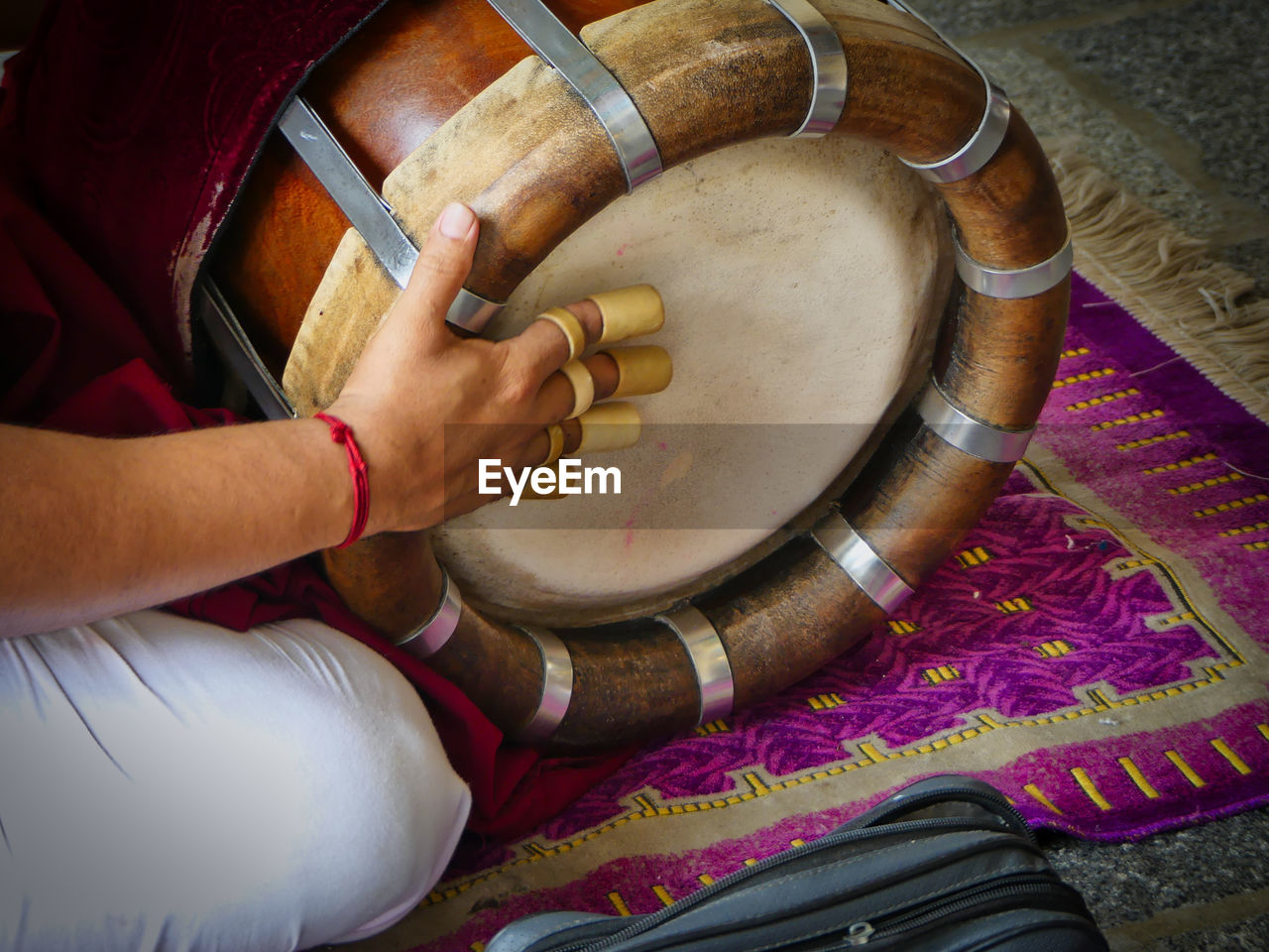 Close-up of man hand playing drum