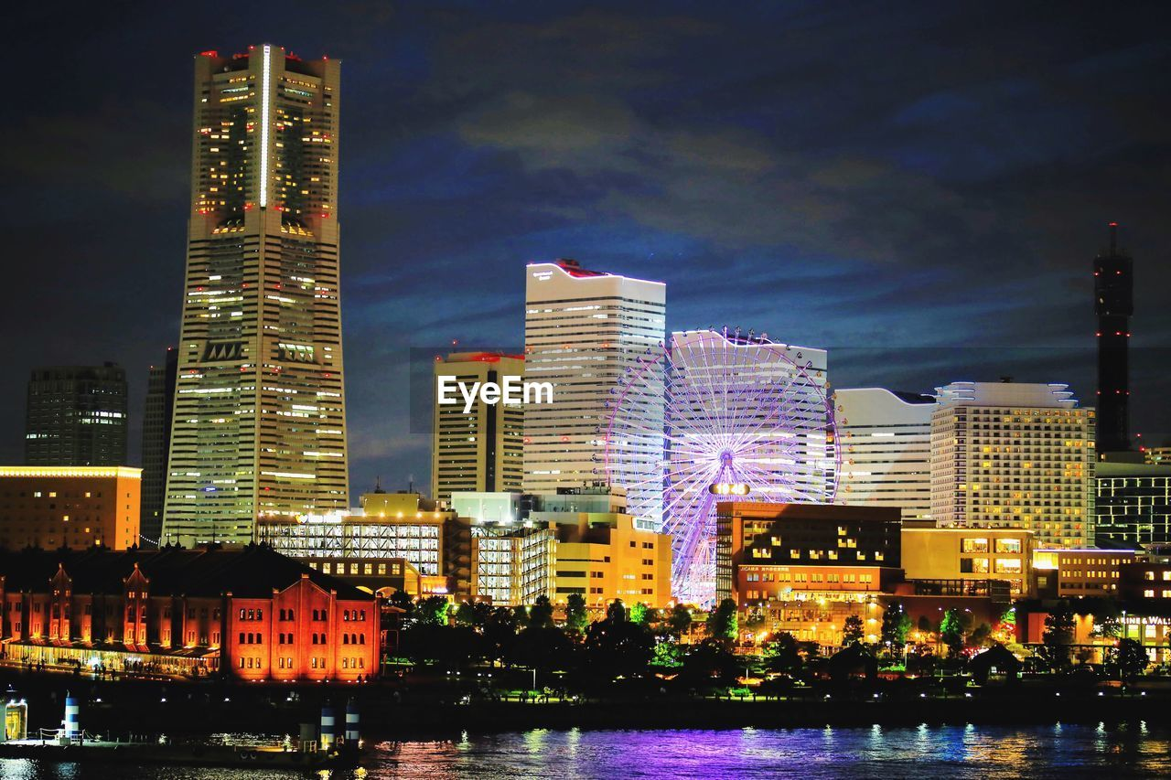 building exterior, architecture, built structure, city, building, illuminated, water, office building exterior, waterfront, sky, night, modern, skyscraper, nature, tower, no people, urban skyline, tall - high, cityscape, outdoors, financial district, bay