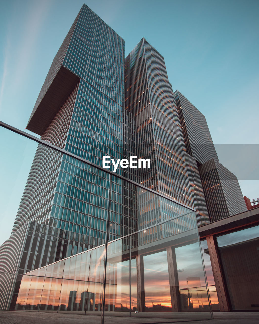 architecture, built structure, building exterior, modern, low angle view, city, building, office building exterior, office, sky, glass - material, tall - high, no people, reflection, skyscraper, nature, tower, day, clear sky, outdoors, financial district