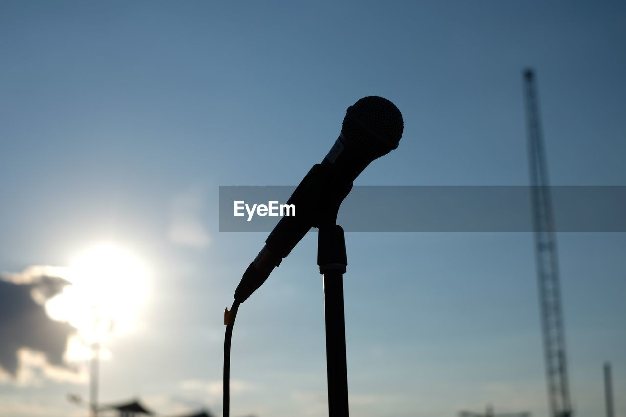 Close-Up Of Microphone Against Sky On Sunny Day