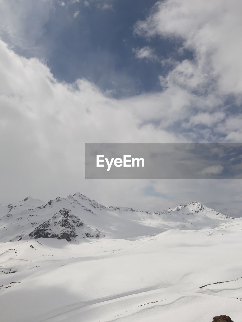 cloud - sky, scenics - nature, mountain, sky, cold temperature, snow, winter, beauty in nature, tranquil scene, tranquility, environment, white color, no people, snowcapped mountain, non-urban scene, nature, landscape, covering, day, mountain peak, range