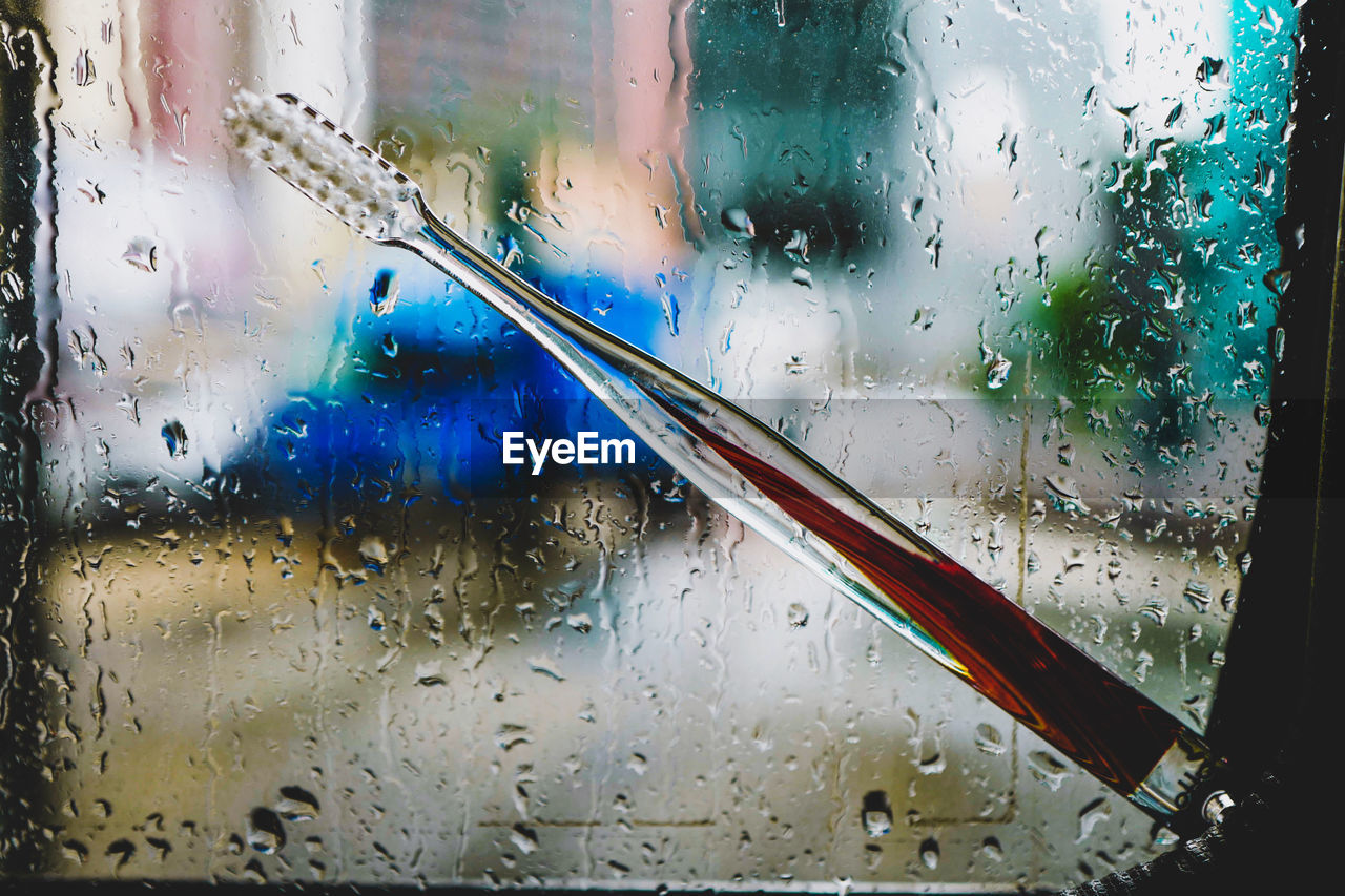 glass - material, drop, transparent, wet, water, window, indoors, close-up, no people, rain, focus on foreground, nature, full frame, blue, raindrop, glass, rainy season, day
