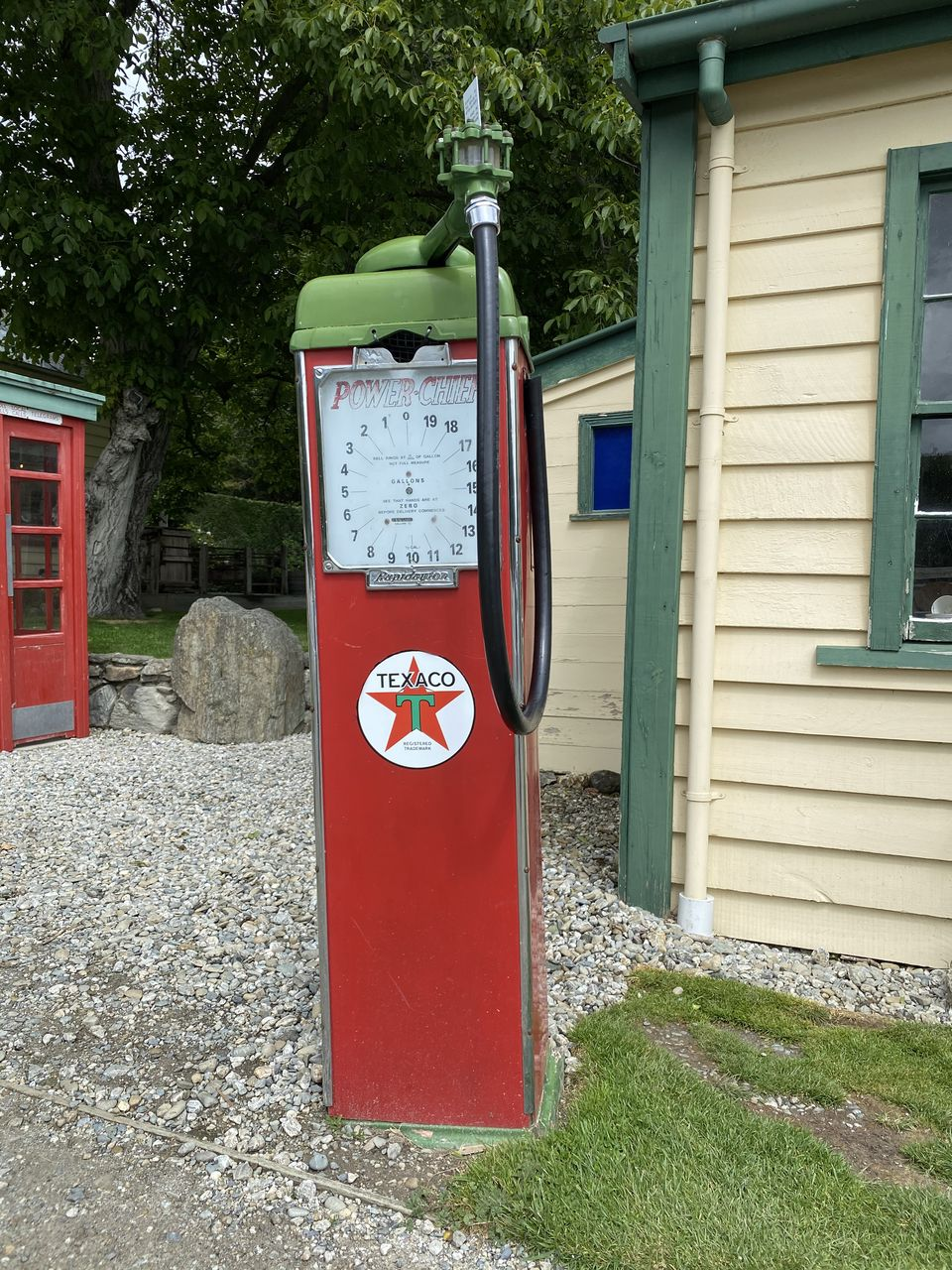 red, building exterior, built structure, architecture, plant, day, no people, building, outdoors, grass, nature, telephone booth, protection, communication, tree, safety, house, public mailbox, mailbox, wall - building feature