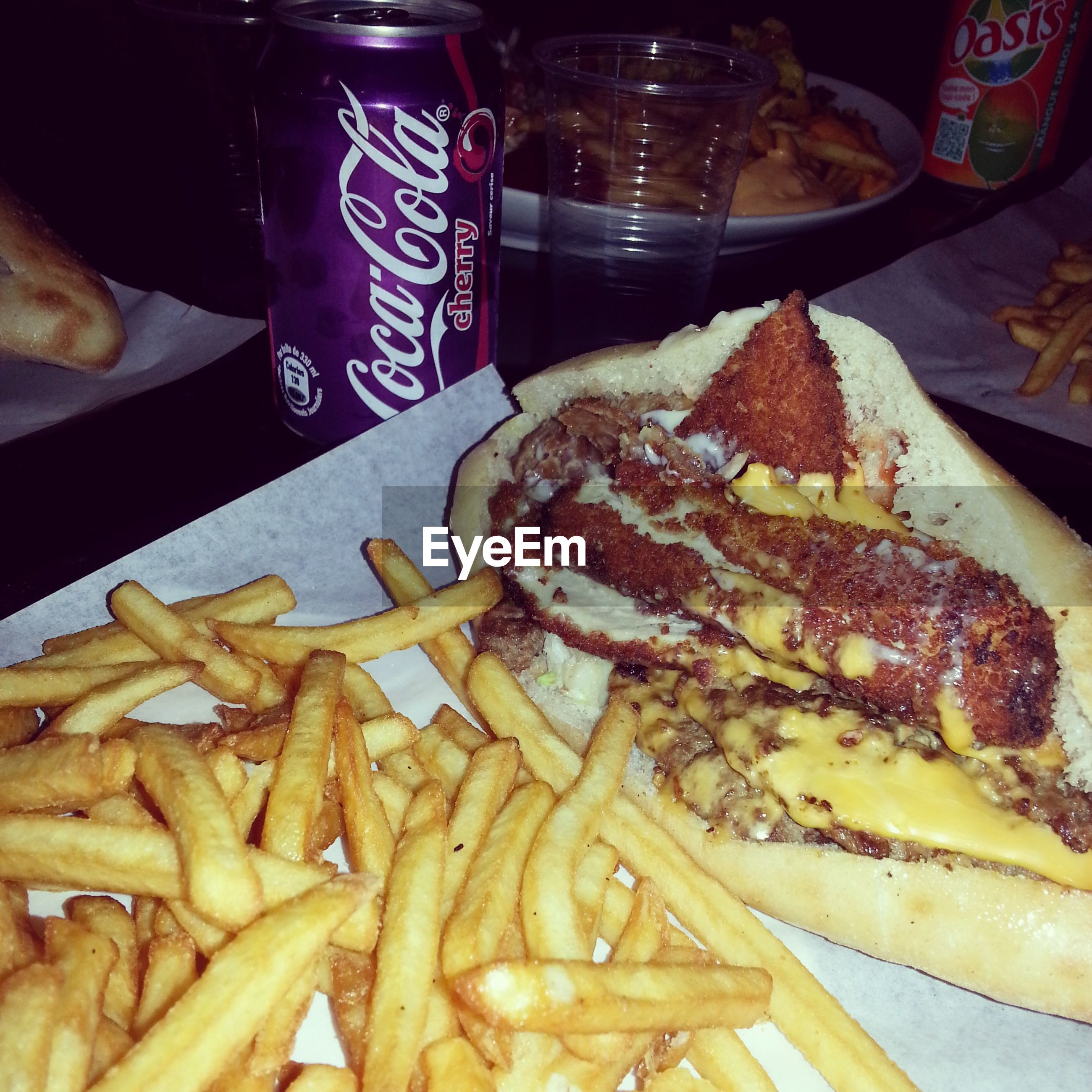 food and drink, food, freshness, indoors, ready-to-eat, still life, unhealthy eating, french fries, table, meat, plate, indulgence, close-up, meal, serving size, fast food, bread, restaurant, deep fried