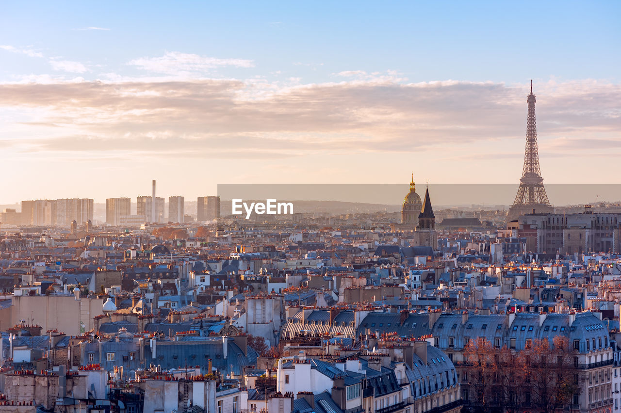 View Of Paris Cityscape At Sunset