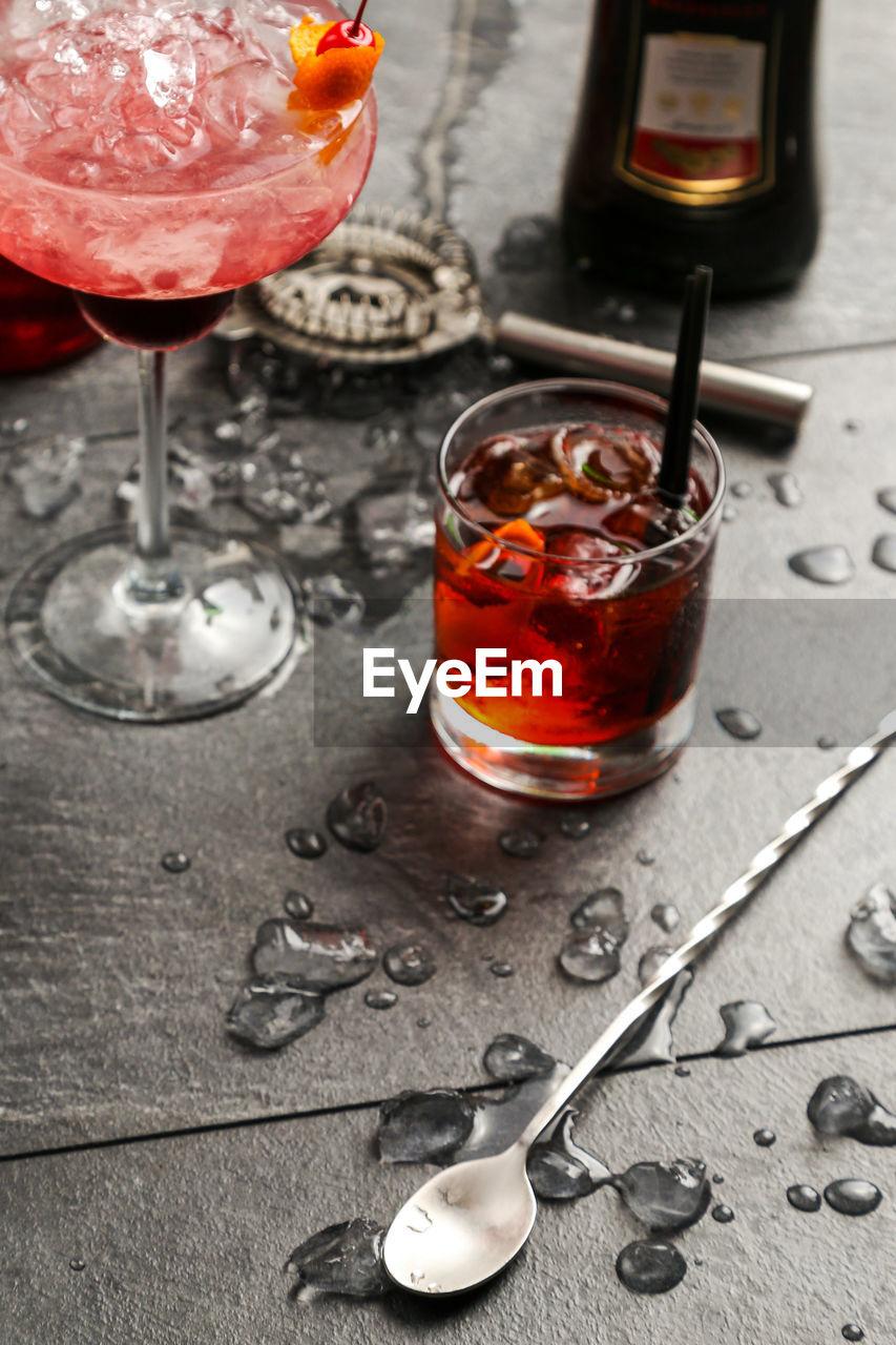 High angle view of drinks on slate