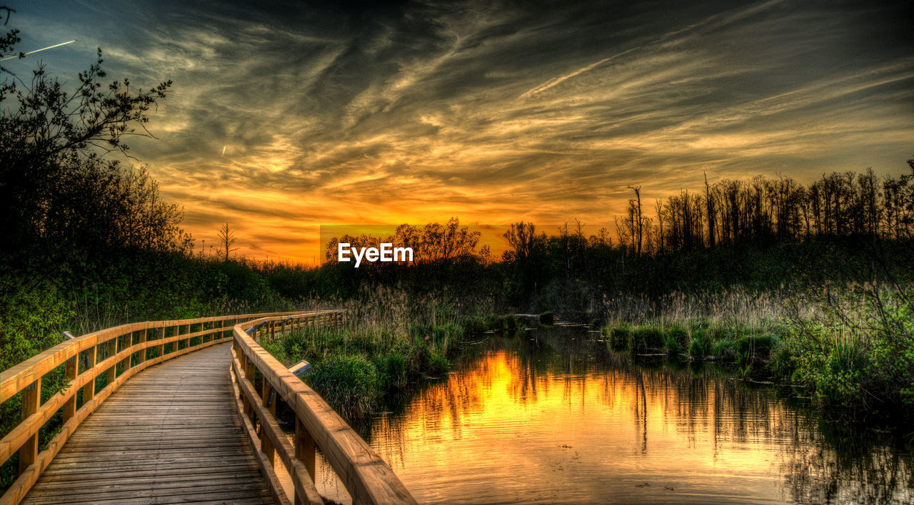 sky, tree, sunset, cloud - sky, water, scenics - nature, plant, lake, orange color, tranquility, beauty in nature, no people, tranquil scene, reflection, direction, nature, the way forward, wood - material, non-urban scene, outdoors