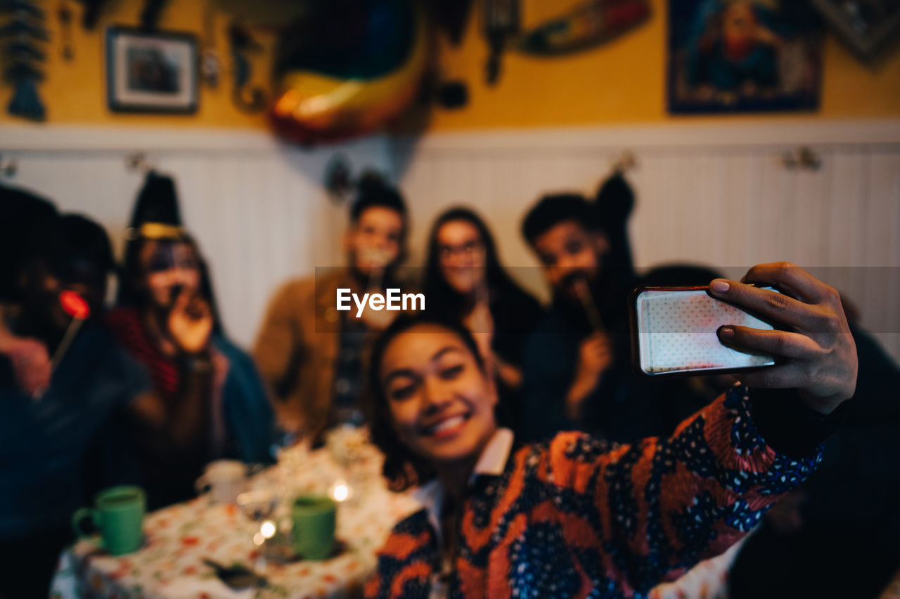 GROUP OF PEOPLE PHOTOGRAPHING AT HOME