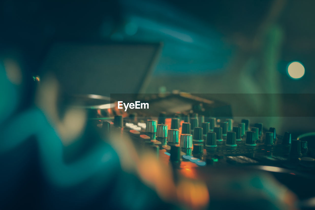 Close-Up Of Sound Mixer At Nightclub
