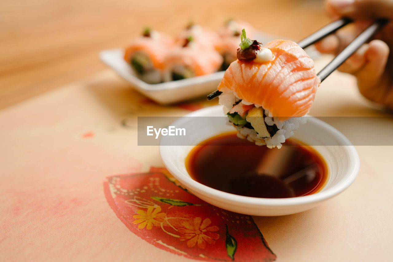 food and drink, food, freshness, seafood, asian food, japanese food, sushi, healthy eating, ready-to-eat, wellbeing, close-up, indoors, rice, sauce, condiment, plate, focus on foreground, serving size, fish, no people, soy sauce, sashimi, savory sauce